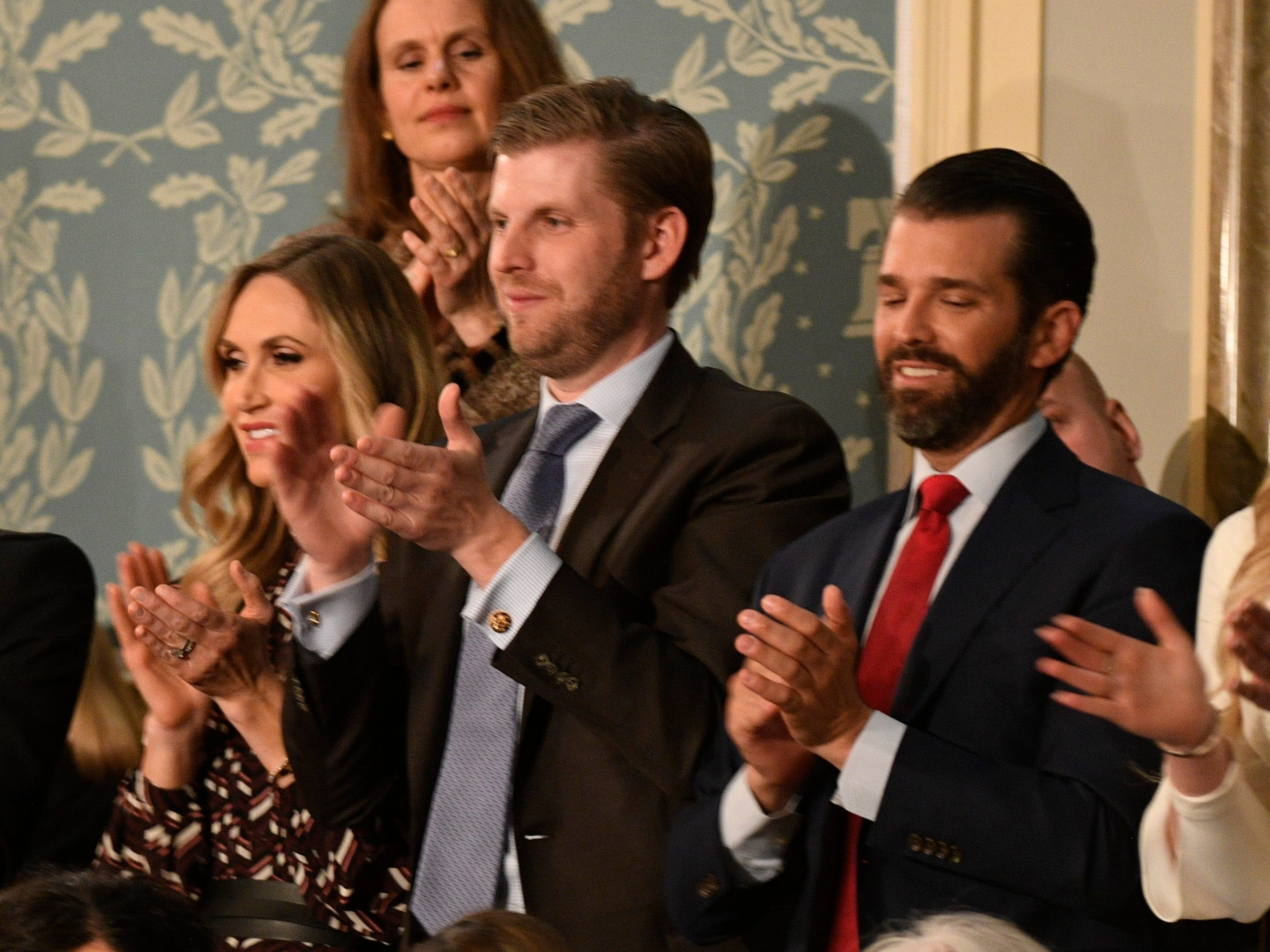 Members of the Trump family applaud as President Donald Trump delivers the State of the Union address.