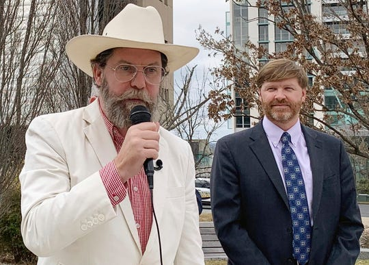 Proud Boys founder Gavin McInnes, left, discusses a lawsuit he filed against the Southern Poverty Law Center during a news conference in Montgomery, Ala., on Monday, Feb. 4, 2019. His attorney, Baron Coleman, listens on the right. McInnes contends the nonprofit organization wrongly labeled the far-right Proud Boys a hate group.