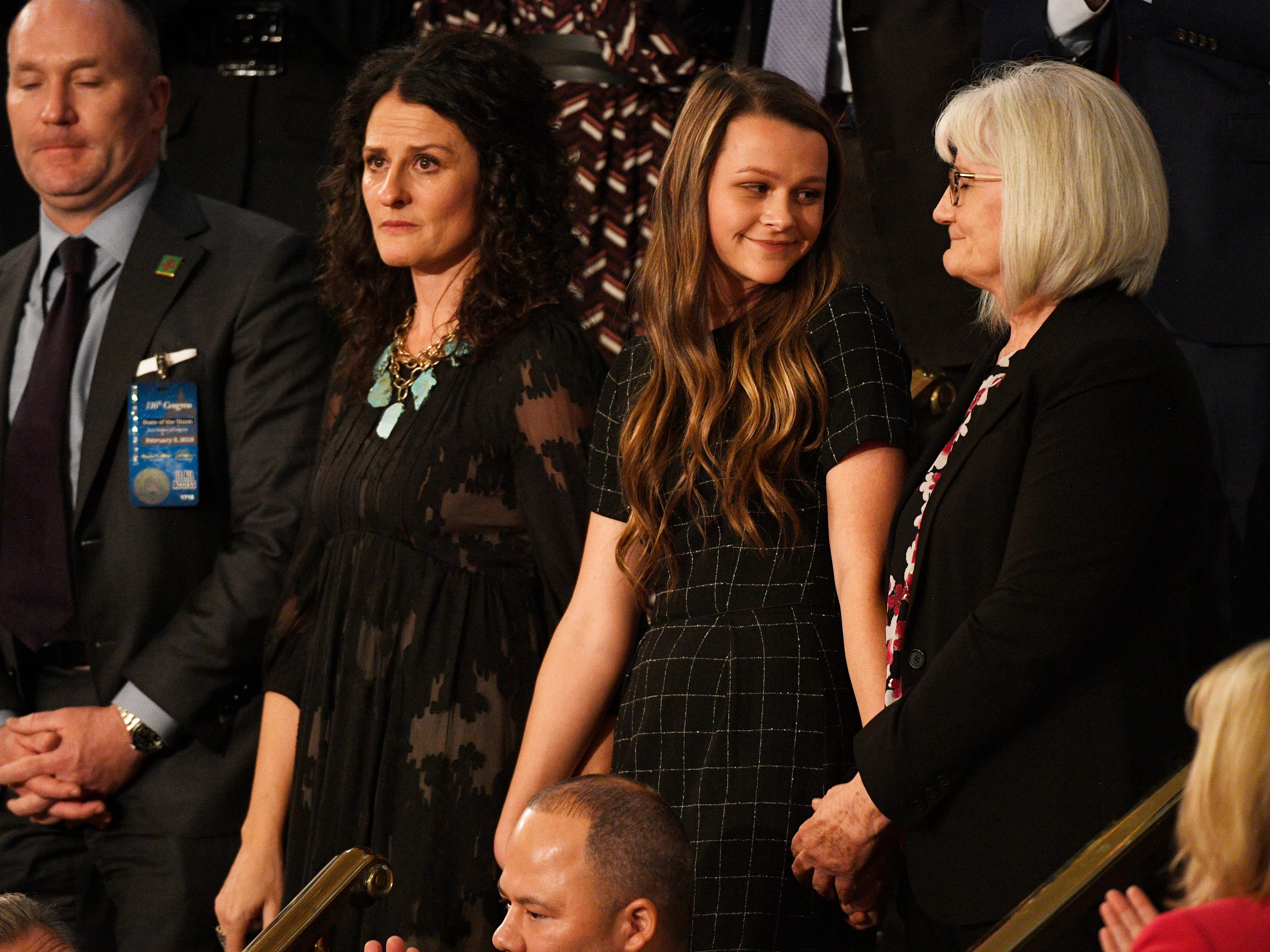Debra Bissell, Heather Armstrong, and Madison Armstrong are recognized by President Donald Trump during the State of the Union address.