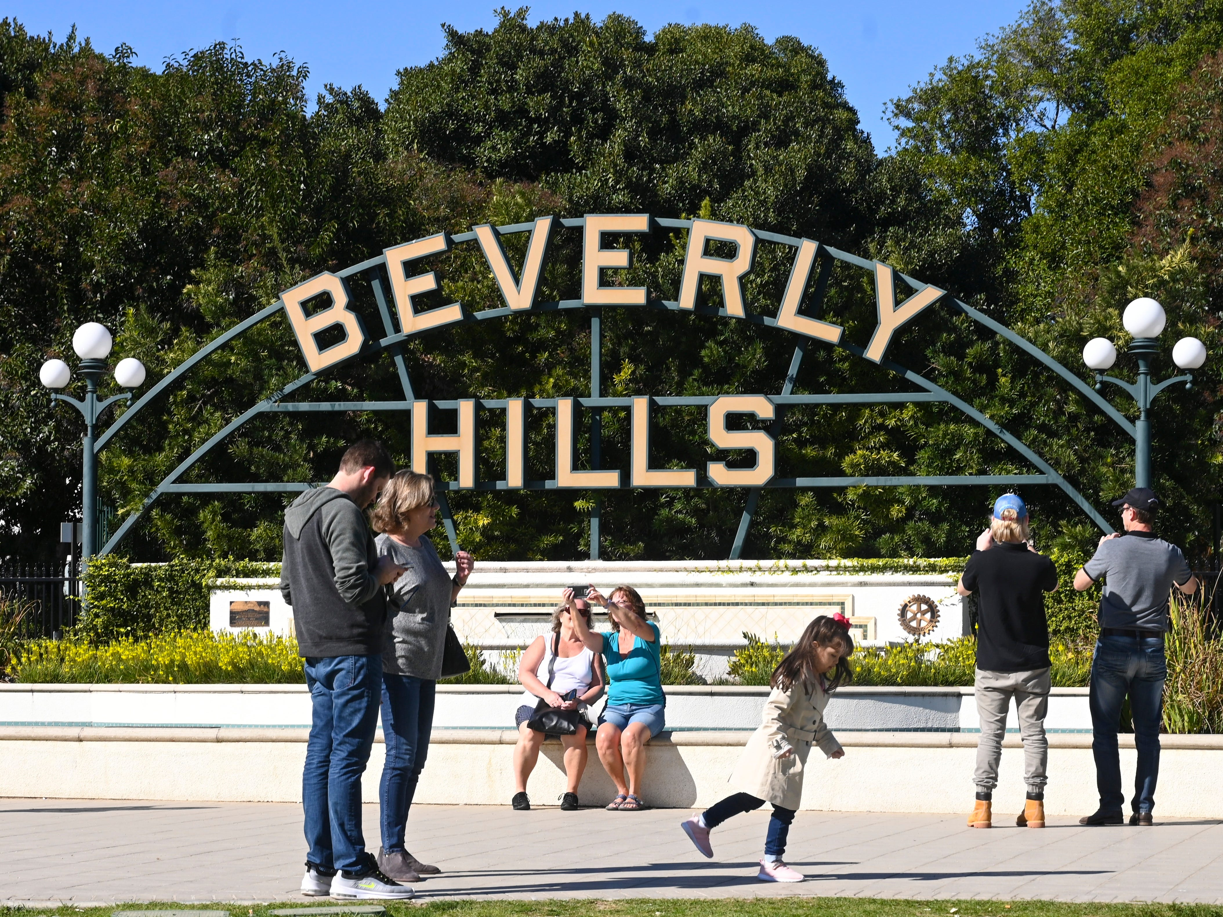 "Tourist gather to take snapshots in front of the ""Beverly Hills"" sign in Beverly Gardens Park, Jan. 29, 2019."