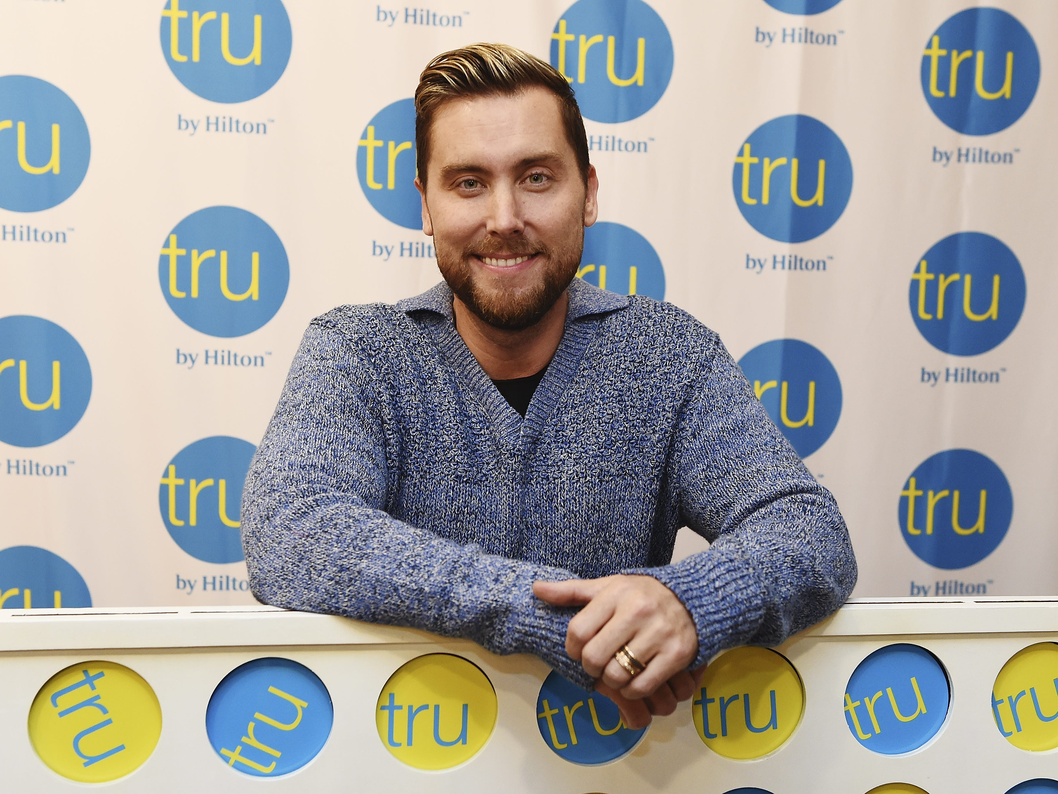 SALT LAKE CITY, UTAH - NOVEMBER 29: *NSYNC member Lance Bass hosts the Tru Connections event, celebrating Tru by Hiltons rapid growth to 50 open hotels with a giant CONNECT 4® tournament at Tru by Hilton Salt Lake City Airport on November 29, 2018 in Salt Lake City, Utah. (Photo by Fred Hayes/Getty Images for Tru by Hilton) ORG XMIT: 775264320 ORIG FILE ID: 1074737806