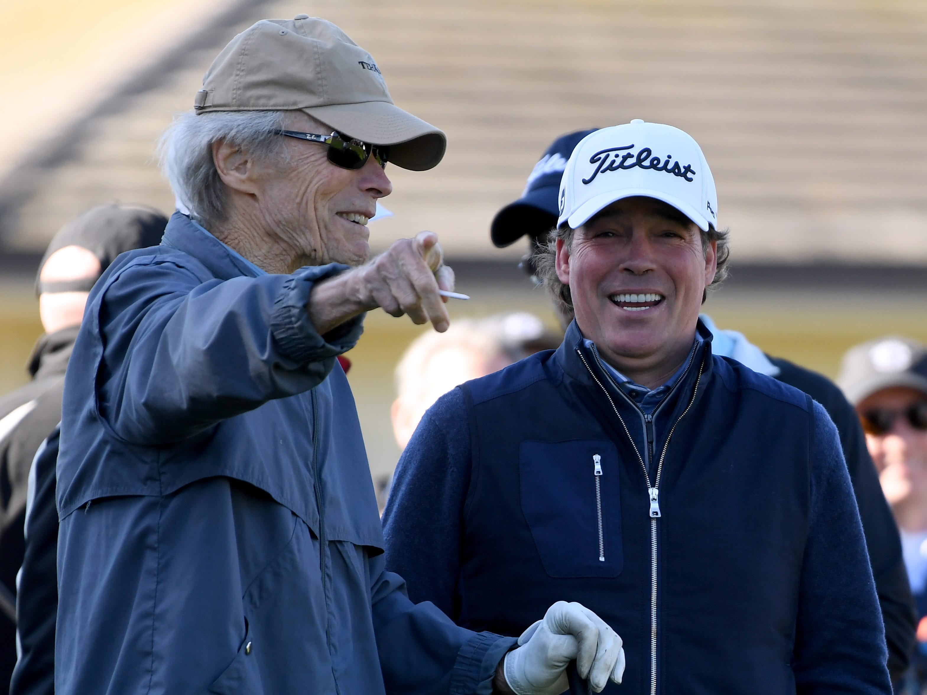 Clint Eastwood, and singer Clay Walker react to a shot on the first hole during the 3M Celebrity Challenge at the AT&T Pebble Beach Pro-Am.