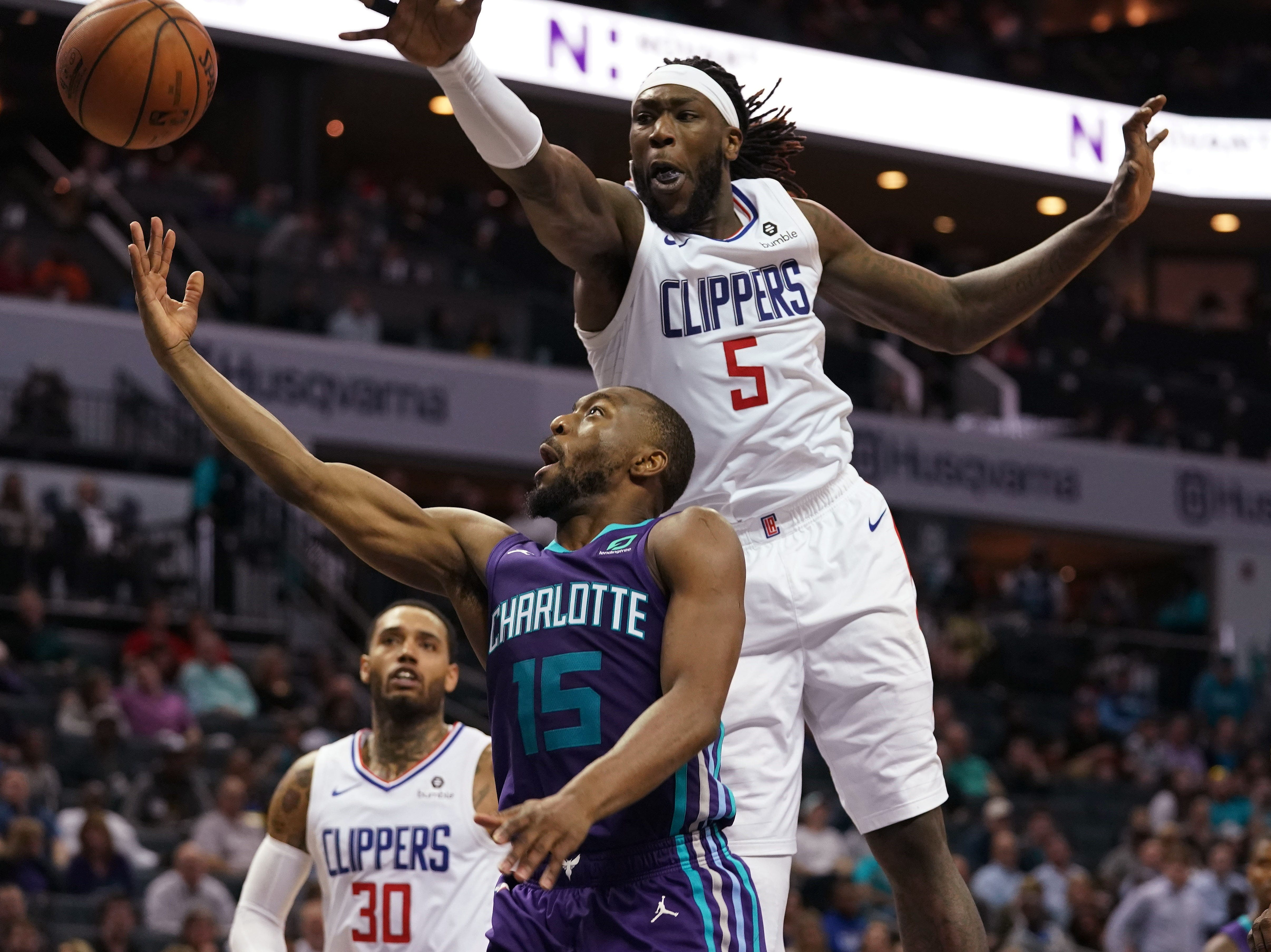 Feb. 5: LA Clippers forward Montrezl Harrell (5) attempts to block a shot by Charlotte Hornets guard Kemba Walker (15) during the second half at the Spectrum Center.