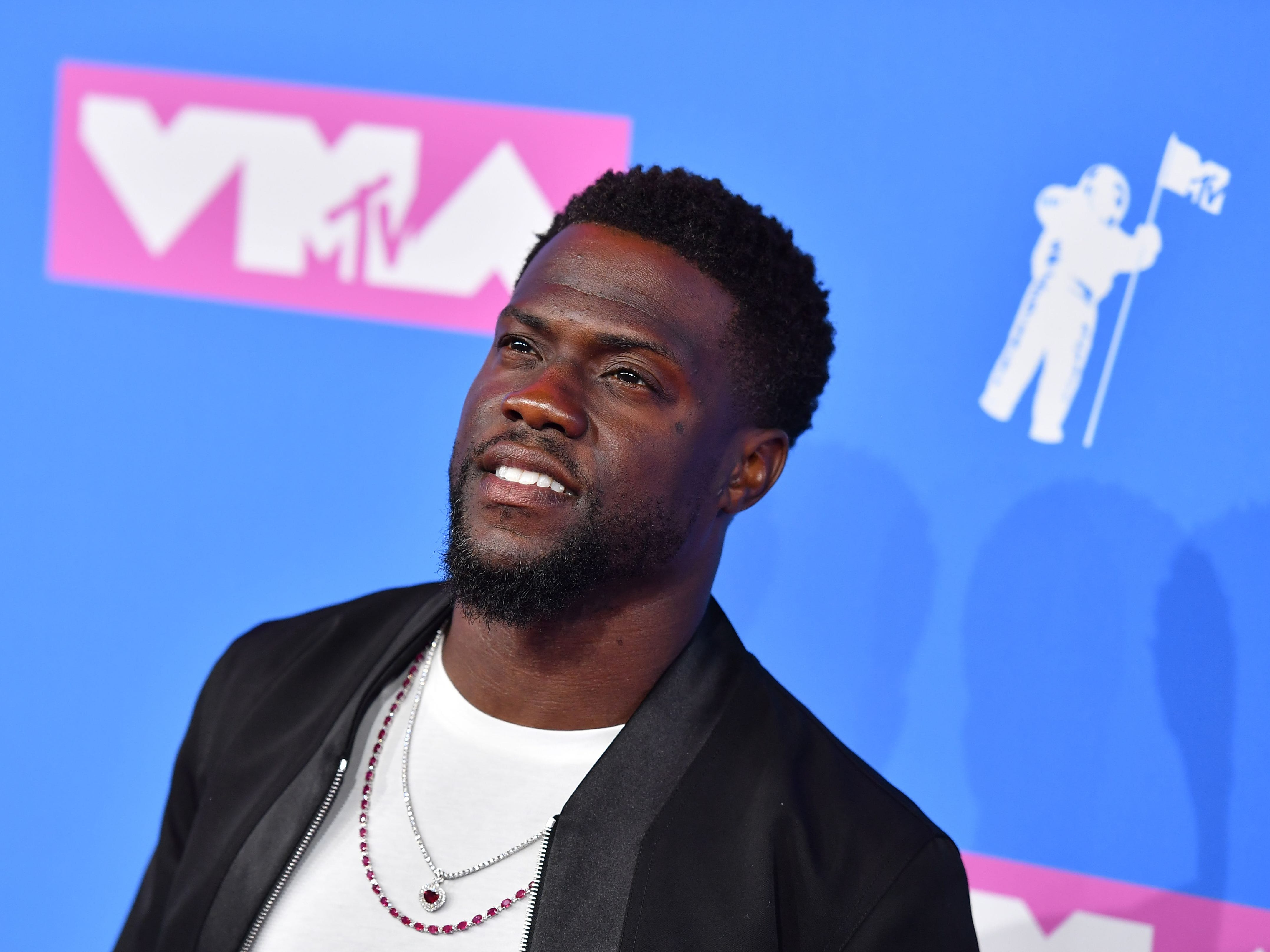 (FILES) In this file photo taken on August 20, 2018, US actor/comedian Kevin Hart attends the 2018 MTV Video Music Awards at Radio City Music Hall on in New York City. - Hollywood's biggest night -- the Oscars -- is set to take place in Febuary 2019 without a host for the first time in 30 years, after comedian Kevin Hart pulled out of the gig and no suitable replacement was found. Though organizers have yet to confirm the plans, entertainment insiders say the show's producers are forging ahead with preparations for the 91st Academy Awards on February 24 with no emcee. (Photo by ANGELA WEISS / AFP)ANGELA WEISS/AFP/Getty Images ORG XMIT: The Oscar ORIG FILE ID: AFP_1CE66G