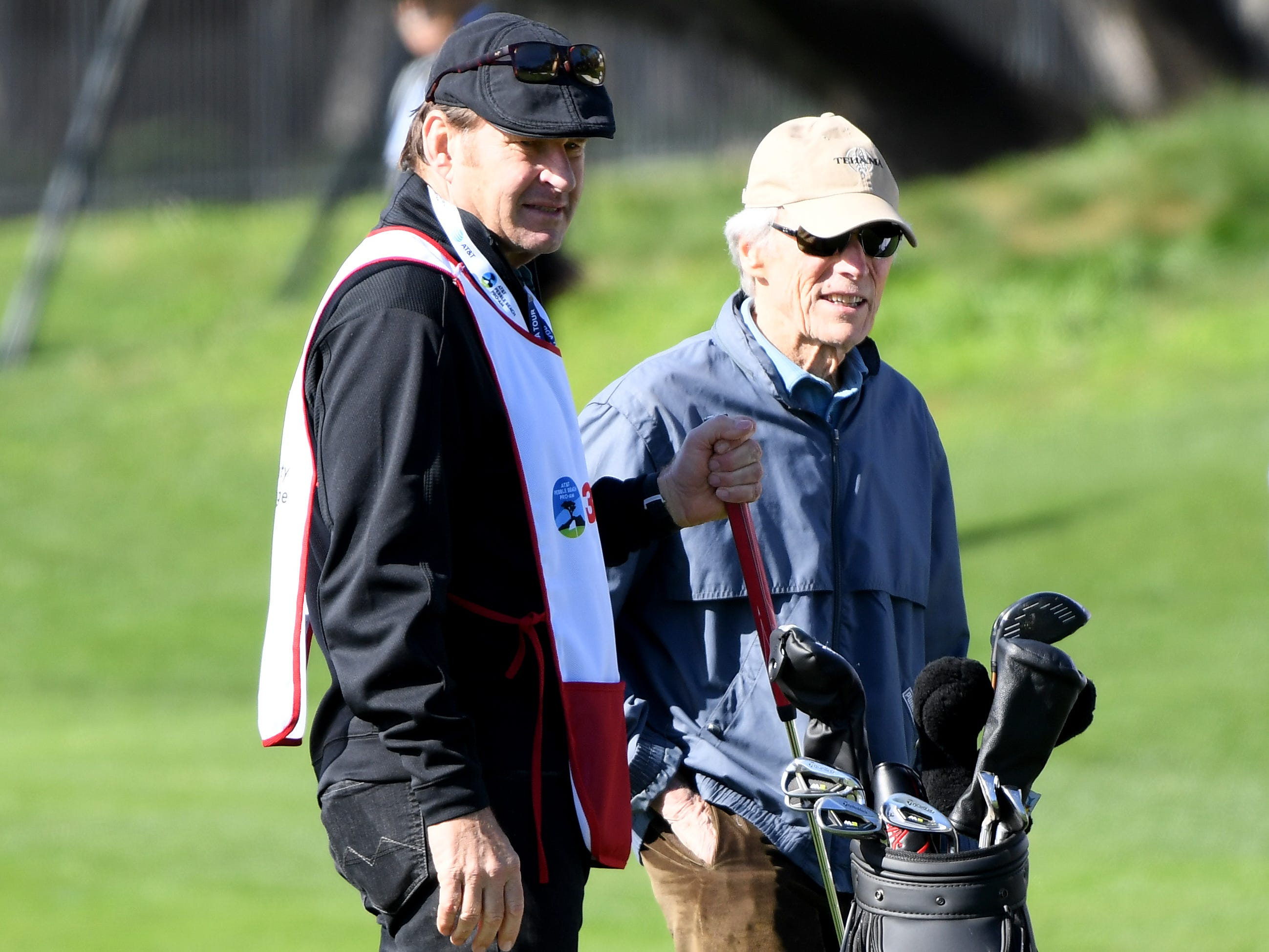 Sir Nick Faldo waits on the green with Clint Eastwood during the 3M Celebrity Challenge at the AT&T Pebble Beach Pro-Am.