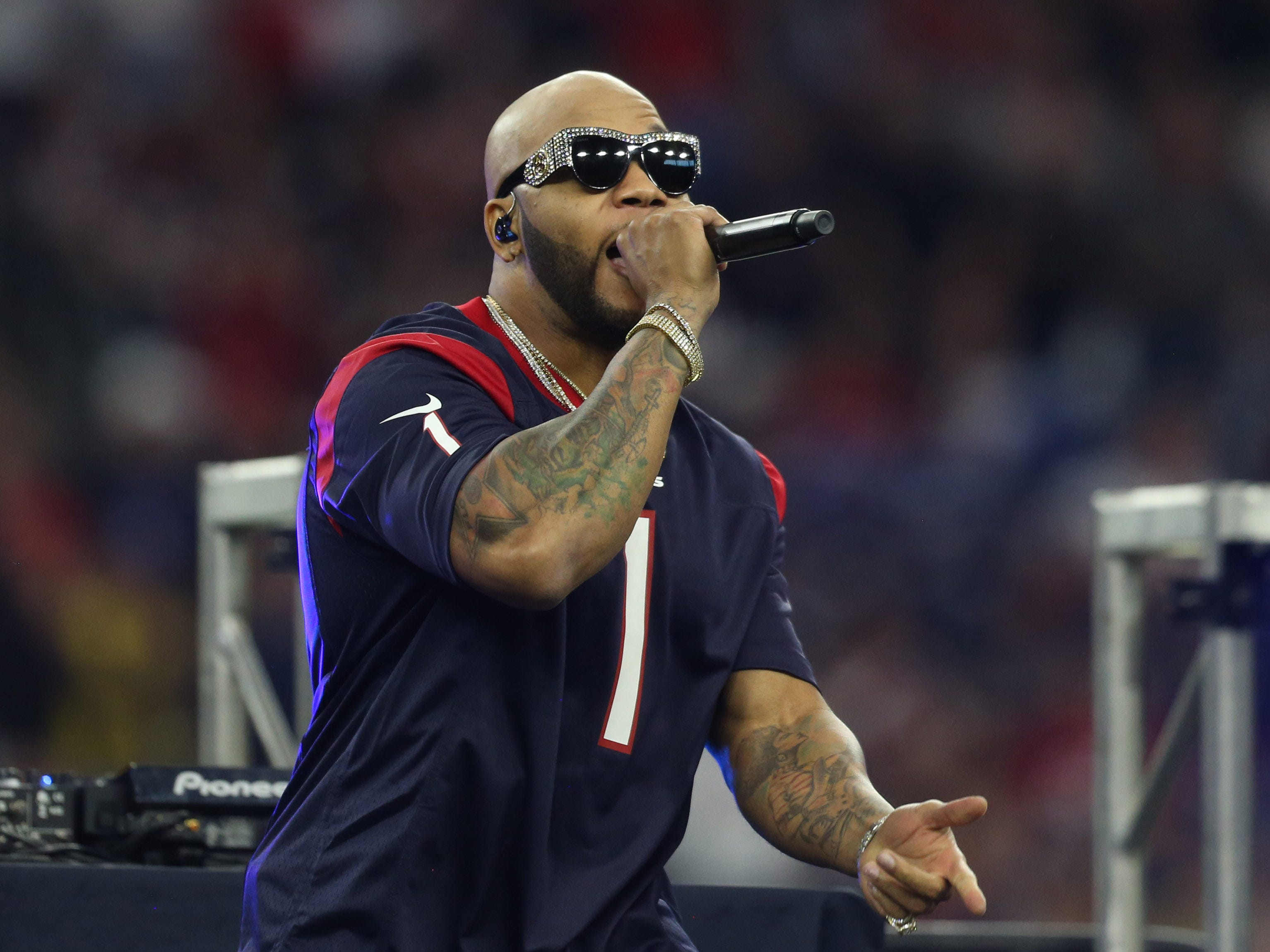 Jan 5, 2019; Houston, TX, USA; Recording artist Flo Rida performs at halftime of a AFC Wild Card playoff football game between the Indianapolis Colts and Houston Texans at NRG Stadium. Mandatory Credit: Thomas B. Shea-USA TODAY Sports ORG XMIT: USATSI-400674 ORIG FILE ID:  20190105_jel_sy9_081.jpg