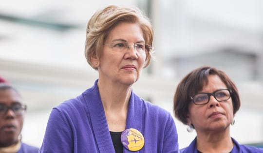 Sen. Elizabeth Warren, D-Mass., listens during a rally for airport workers affected by the government shutdown at Boston Logan International Airport on Jan. 21, 2019 in Boston, Massachusetts.
