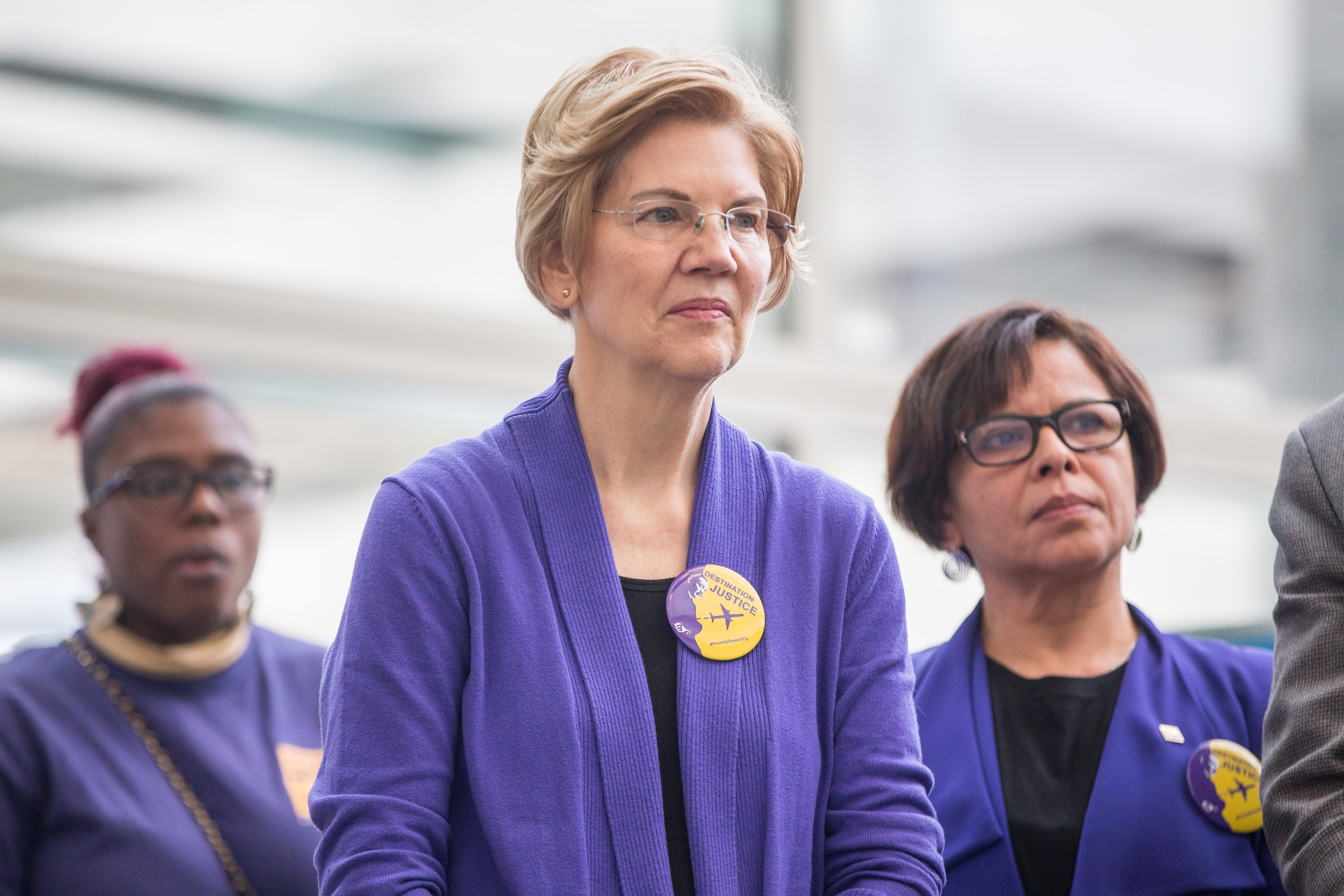 Sen. Elizabeth Warren, D-Mass., listens all the contrivance via a rally for airport workers tormented by the authorities shutdown at Boston Logan Worldwide Airport on Jan. 21, 2019 in Boston, Massachusetts.