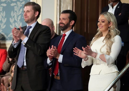 Eric Tump, left, Donald Trump Jr., center, and Tiffany Trump applaud as President Donald Trump delivers his State of the Union address to a joint session of Congress on Capitol Hill in Washington, D.C., Feb. 5, 2019.