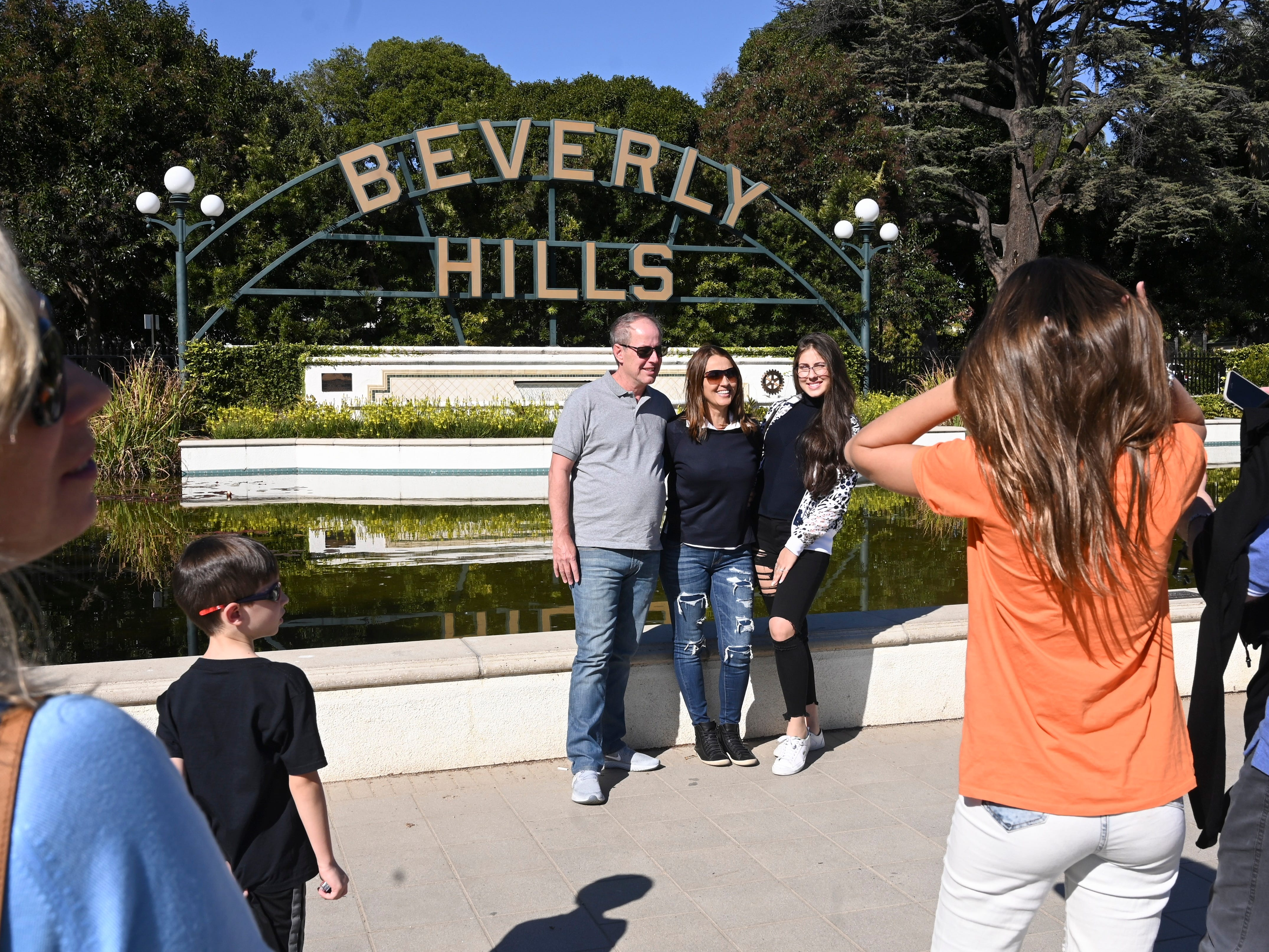 "1/25/19 1:32:23 PM -- Beverly Hills, CA, U.S.A: Tourist line up to take snapshots in front of the ""Beverly Hills"" sign in Beverly Gardens Park on Santa Monica near Rodeo Drive. Photo by Robert Hanashiro, USA TODAY staff