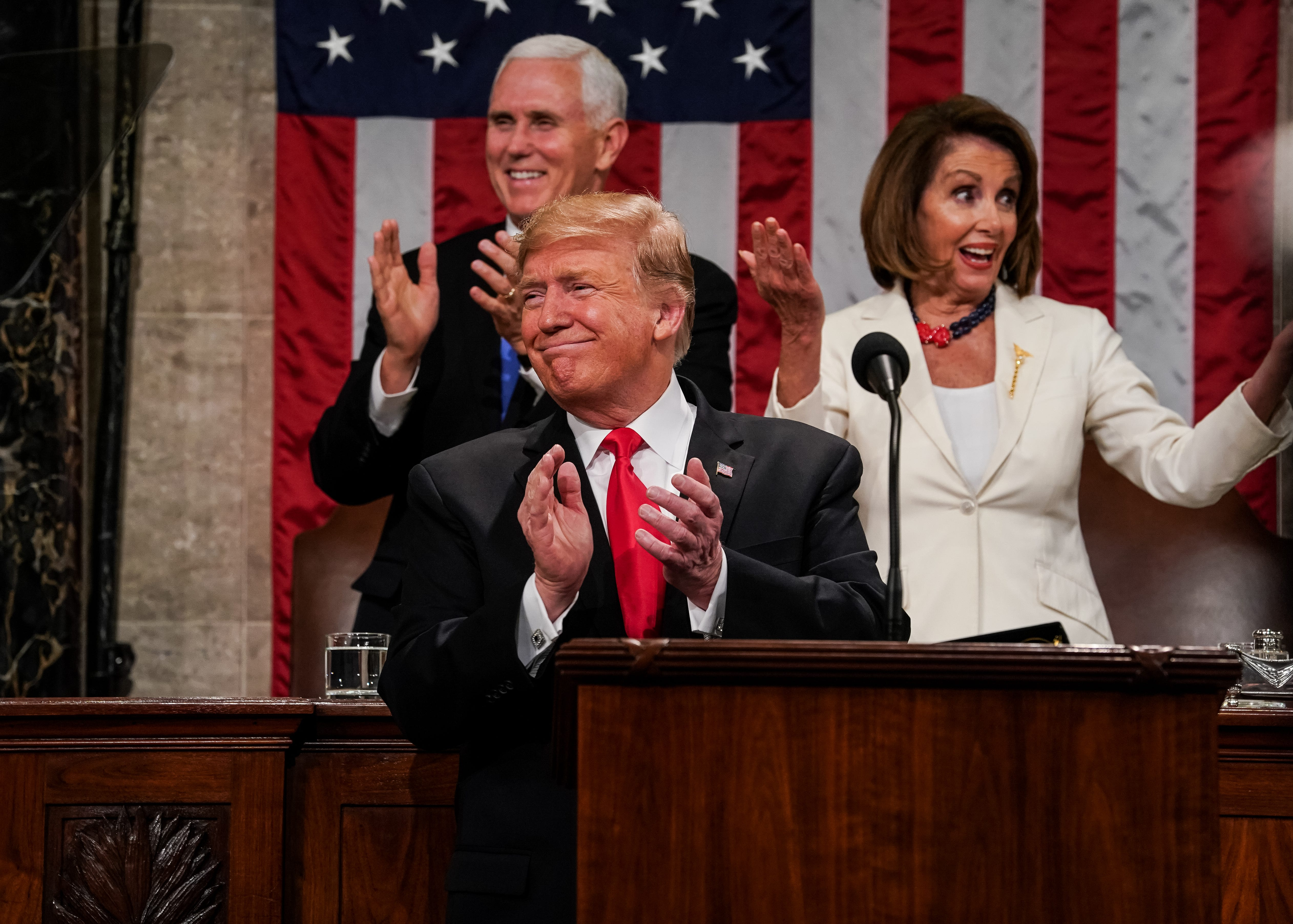 President Donald Trump, Speaker Nancy Pelosi and Vice President Mike Pence applaud during the State of the Union address in the chamber of the U.S. House of Representatives at the U.S. Capitol .