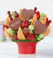 Prices for Fruit Bouquets' Hearts and Kisses arrangement start at $49.99.