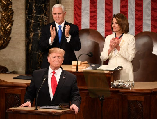 President Donald Trump delivers the State of the Union address Tuesday, Feb. 5, 2019, from the House chamber of the U.S. Capitol in Washington. Vice President Mike Pence and Speaker of the House Nancy Pelosi, D-Calif., are behind Trump.