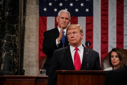 President Donald J. Trump (C) delivers the State of the Union address, with Vice President Mike Pence and Speaker of the House Nancy Pelosi, at the Capitol in Washington, D.C, February 5, 2019.