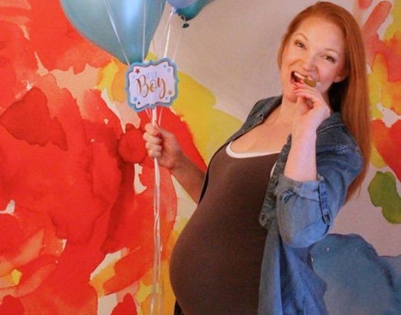 Heather Green, mother of Adrian Brown, 20, sports a faux baby bump, during her son's transgender coming out photo shoot.