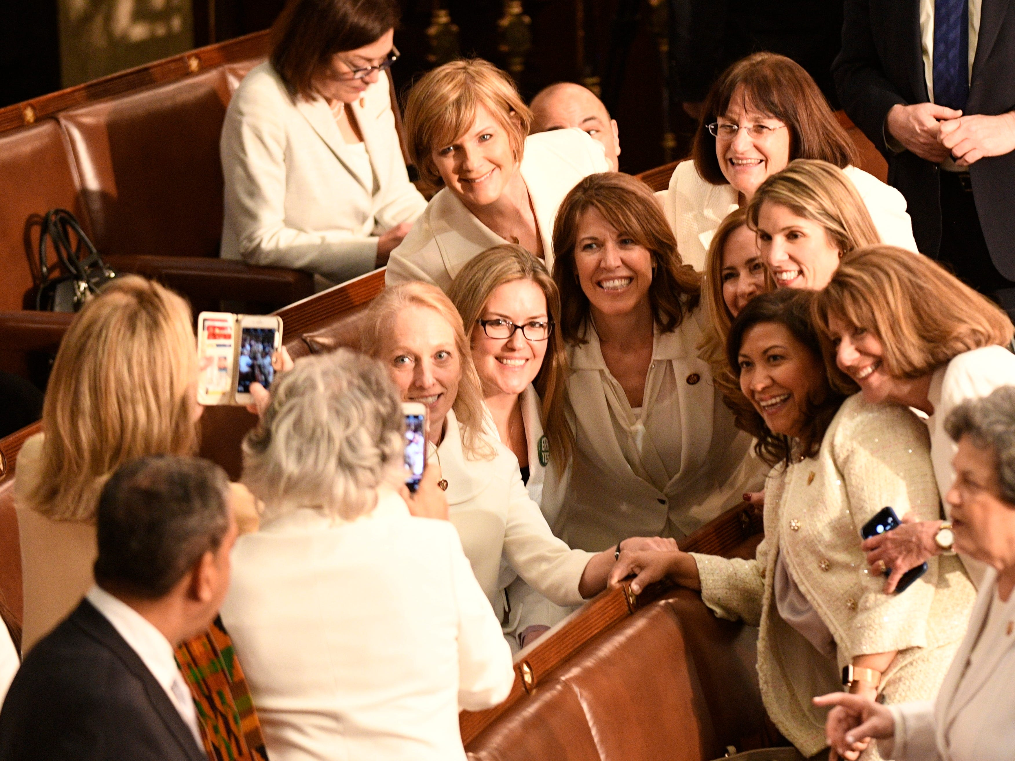 Women members of Congress gather for photographs prior to President Donald Trump delivering the State of the Union address, Feb. 5, 2019.
