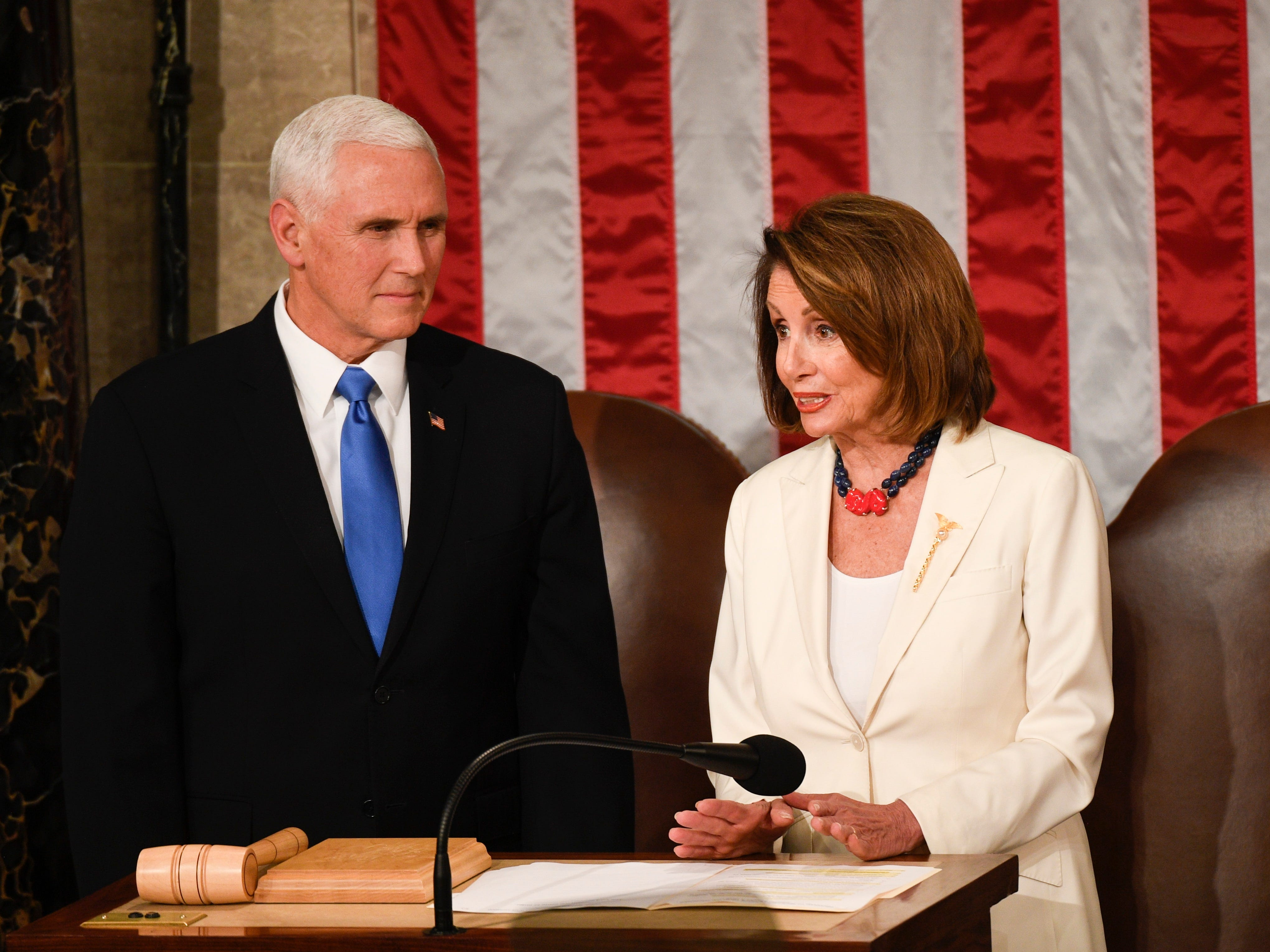 Vice President Mike Pence and Speaker of the House Nancy Pelosi (D-Calif.) talk before President Donald Trump delivers the State of the Union address.