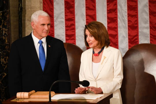 Vice President Mike Pence and Speaker of the House Nancy Pelosi, D-Calif., talk before President Donald Trump delivers the State of the Union address Feb. 5, 2019.