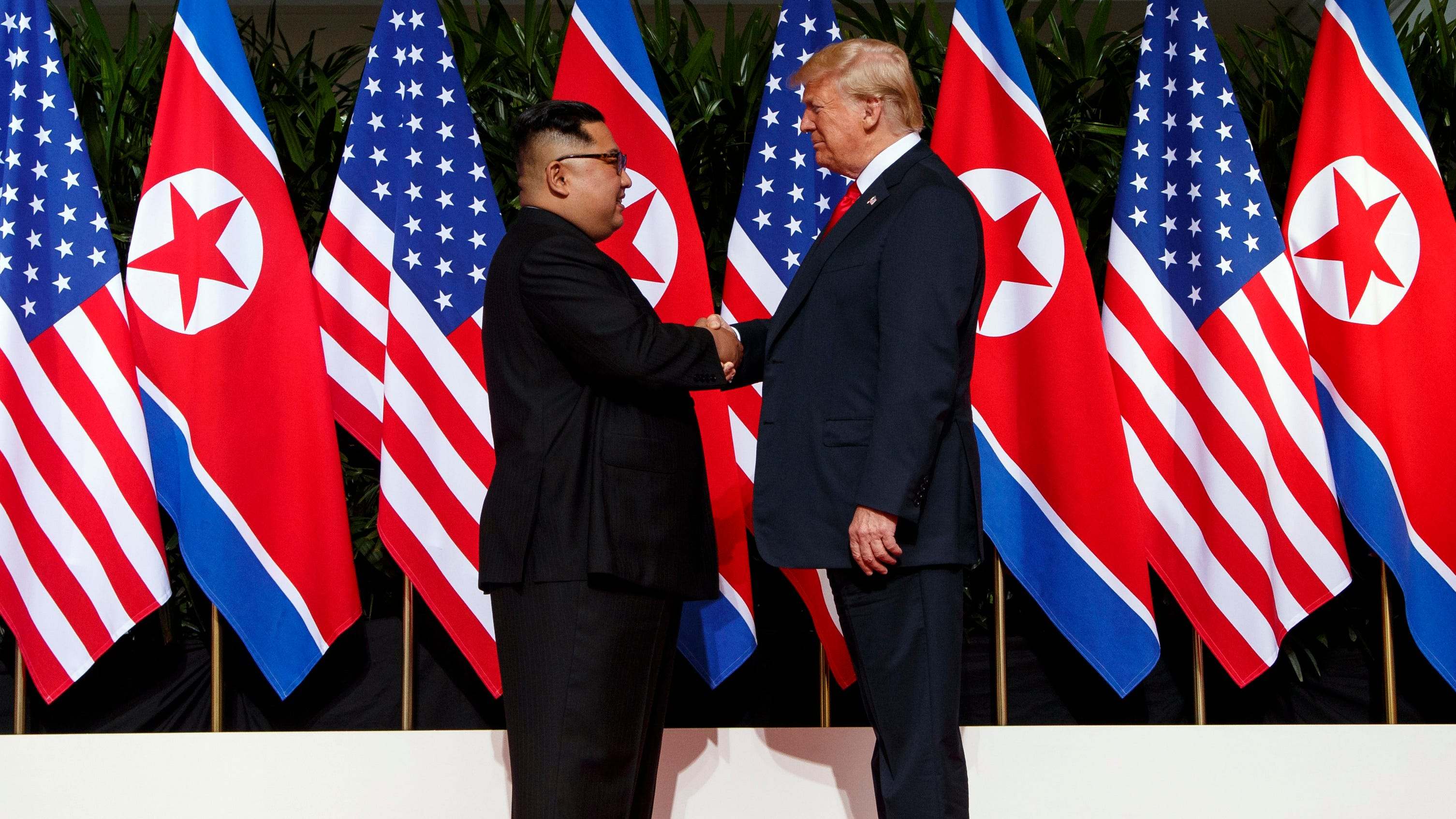 North Korean leader Kim Jong Un, left, and President Donald Trump shake hands on Sentosa Island in Singapore on June 12, 2018.