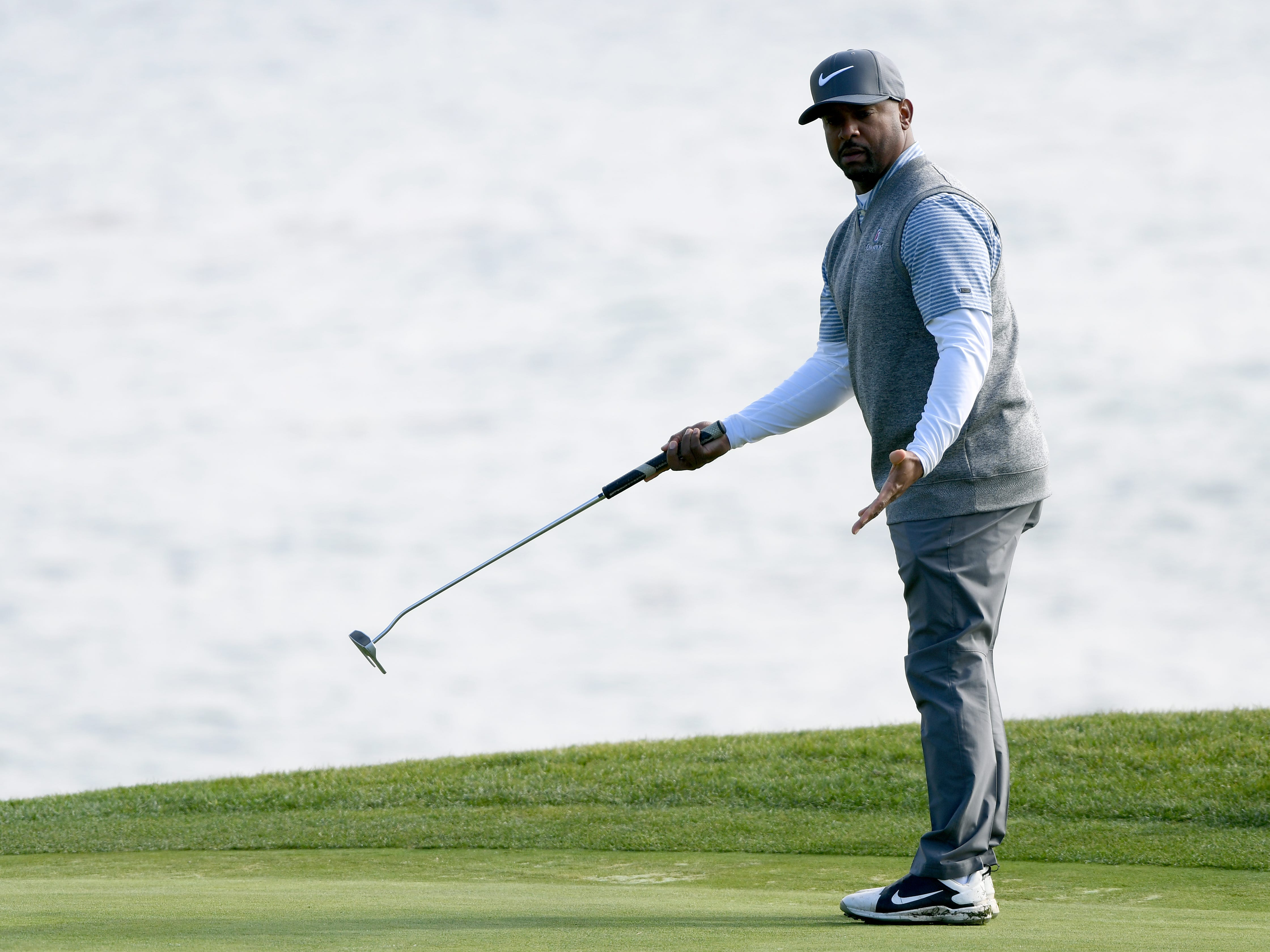 Alfonso Ribeiro reacts to his missed putt on the 18th green during the 3M Celebrity Challenge at the AT&T Pebble Beach Pro-Am.