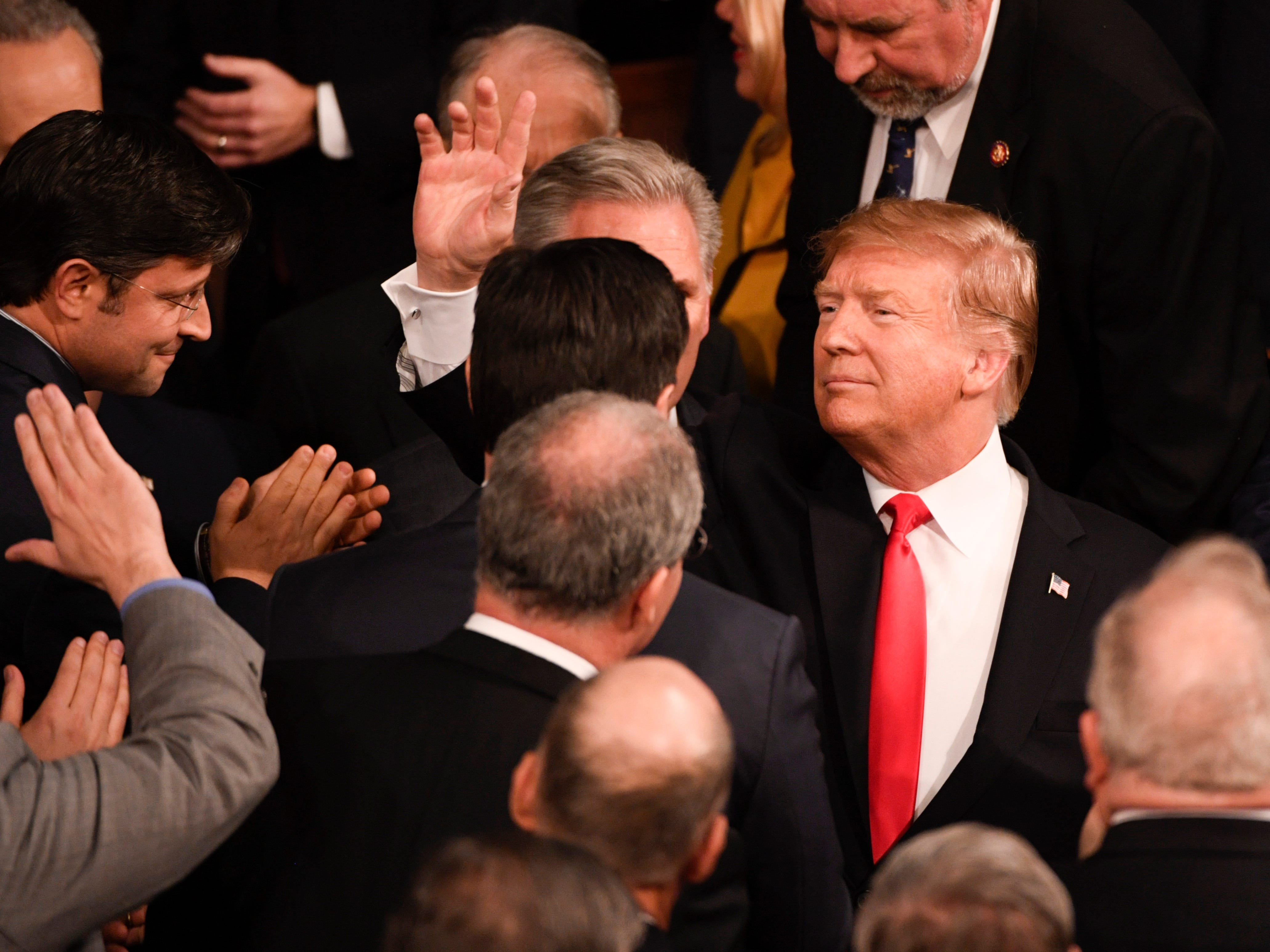 President Donald Trump enters before he delivers the State of the Union address.