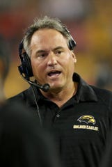 Southern Miss coach Jay Hopson disagrees with the school's decision to no longer consider Art Briles for the team's offensive coordinator.