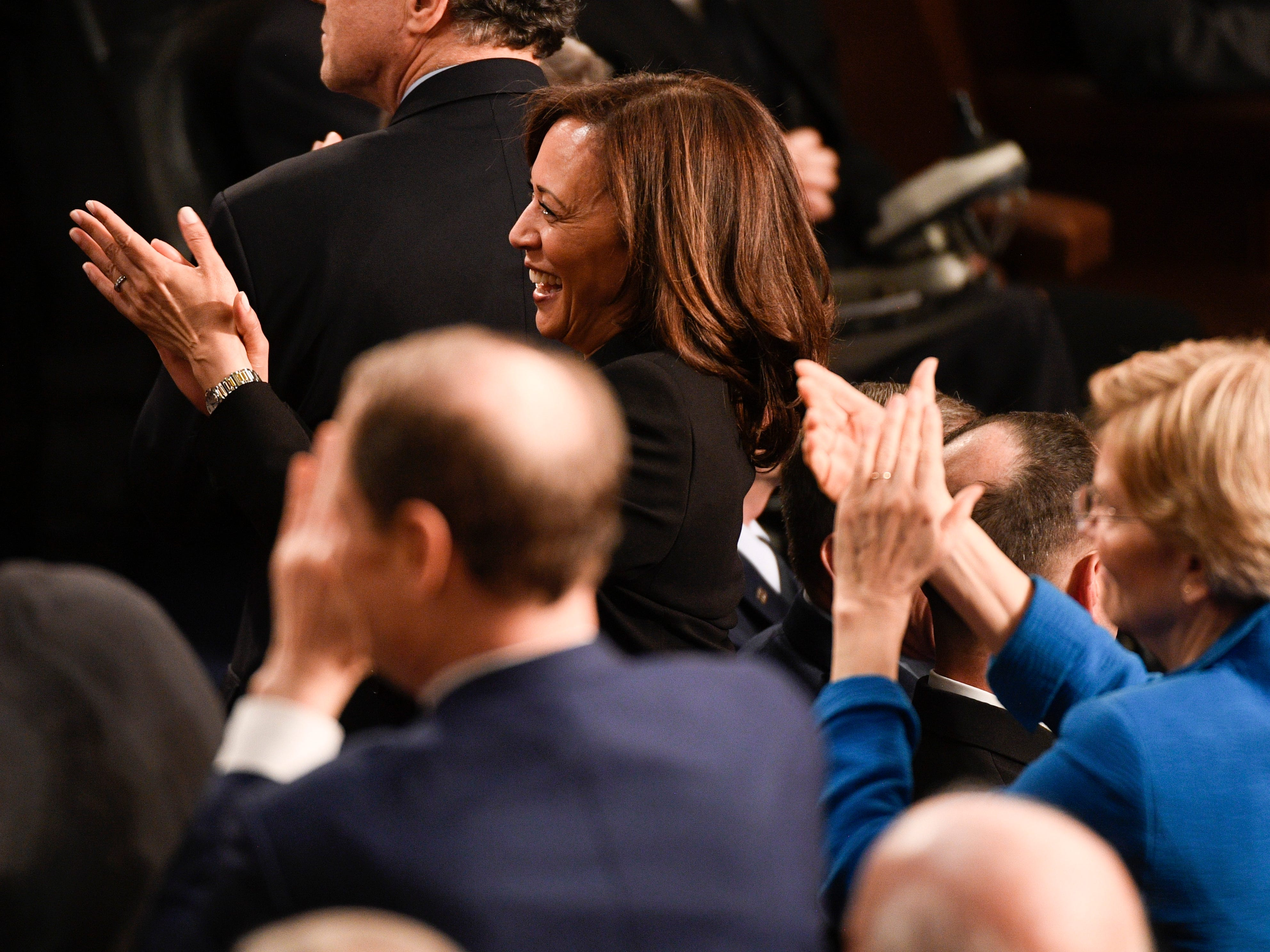 Sen. Kamala Harris (D-Calif.) and Sen. Elizabeth Warren (D-Mass.) applaud as President Donald Trump recognized Congresswomen as he delivers the State of the Union address.
