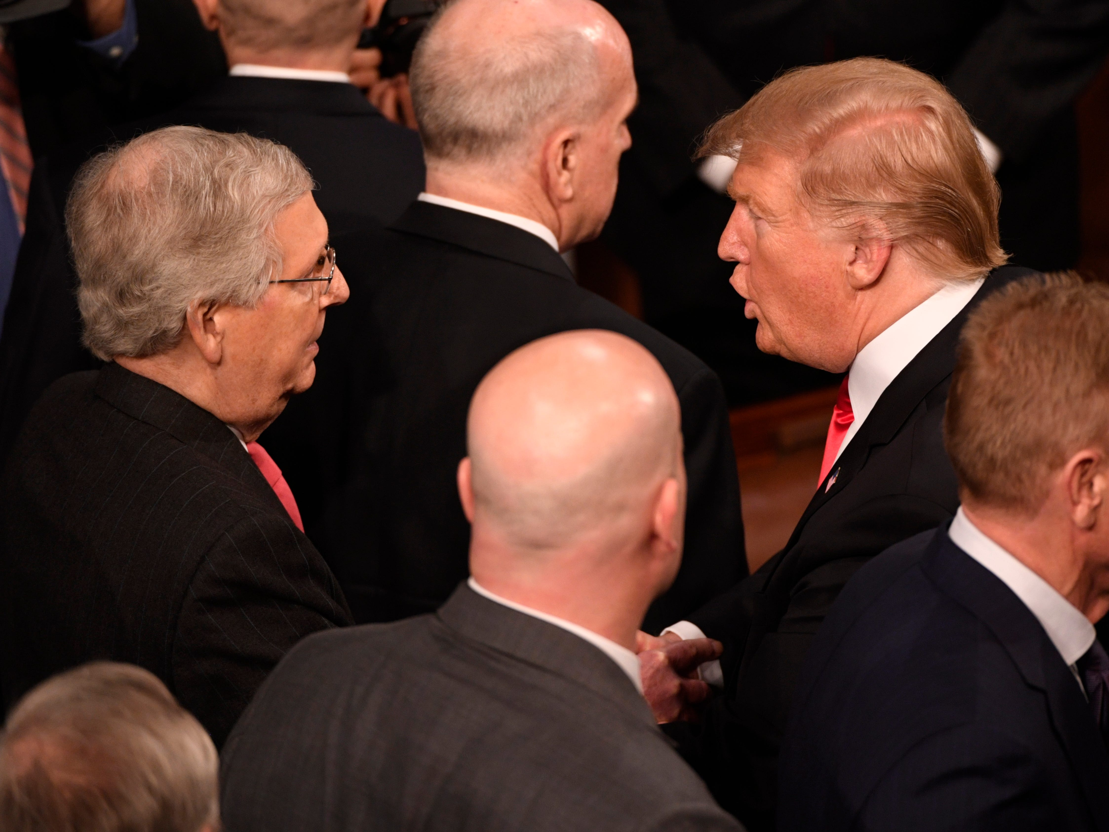 President Donald Trump greets Sen. Mitch McConnell (R-Ky.) after he delivered the State of the Union address.