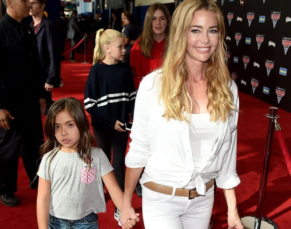 "Denise Richards and daughter Eloise attend the premiere of Disney and Pixar's ""Cars 3"" in 2017. Richards says she's learning the best way to parent her daughter with special needs on a daily basis."