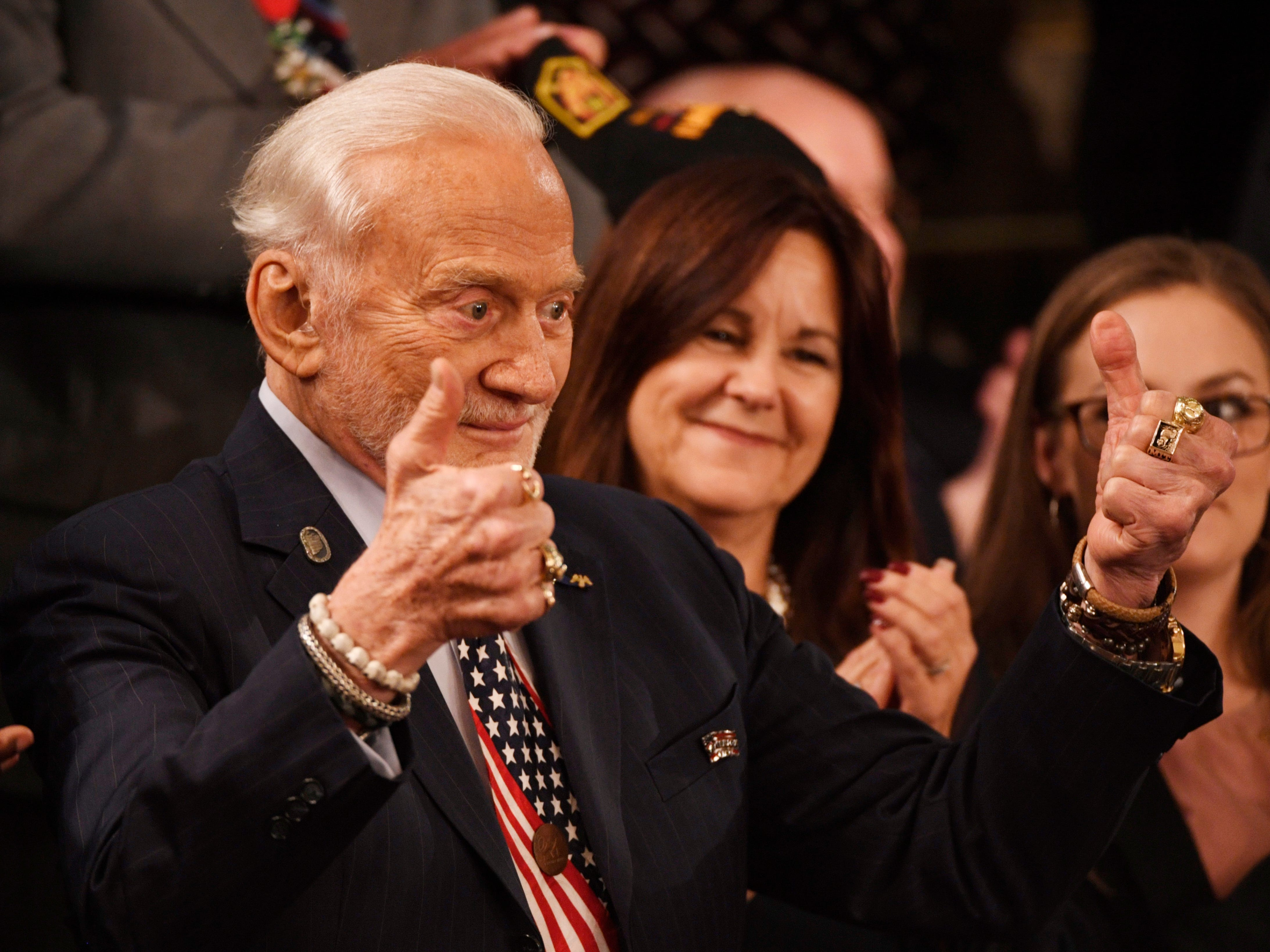 Astronaut Buzz Aldrin gives the thumbs up as President Donald Trump delivers the State of the Union address.  Aldrin landed on the moon in 1969 in Apollo 11.