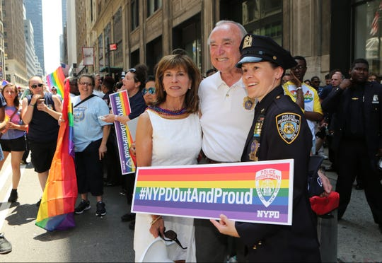 New York City police commissioner Bill Bratton poses for a photo with some his troops before the 2016 NYC Pride March. (Photo: Mark Vergari/The Journal News)