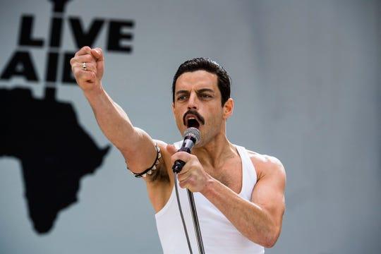 "Freddie Mercury (Rami Malek) performs at Live Aid in the Queen biopic ""Bohemian Rhapsody."""