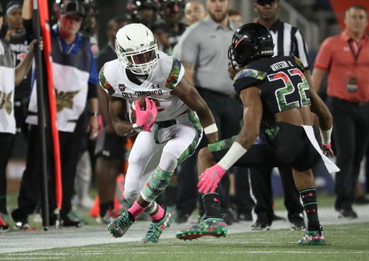 George Pickens runs with the ball during the second half of the Under Armour All-America Game in 2018.