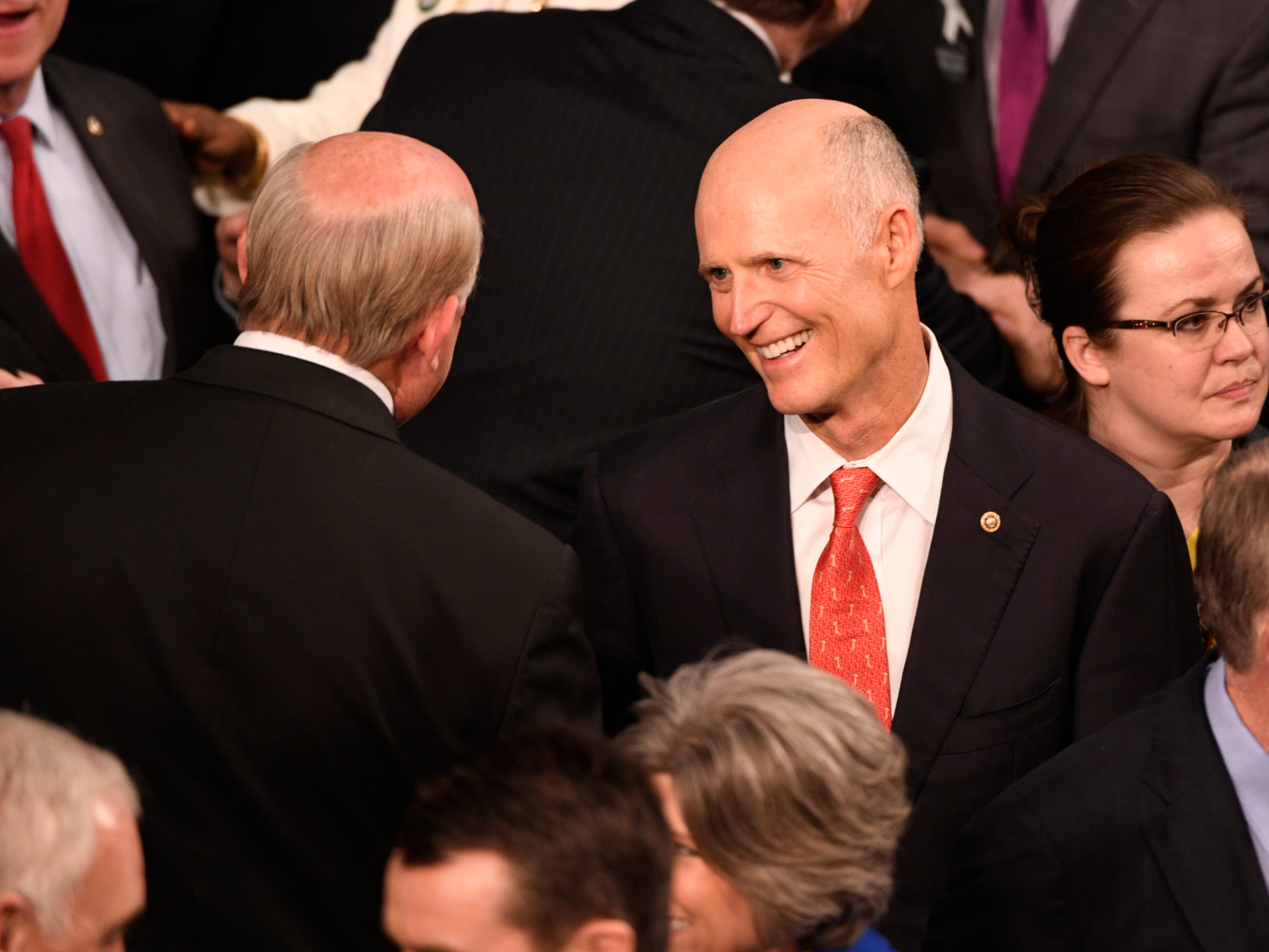 Sen. Rick Scott (R-Fla.) talks before President Donald Trump delivers the State of the Union address.