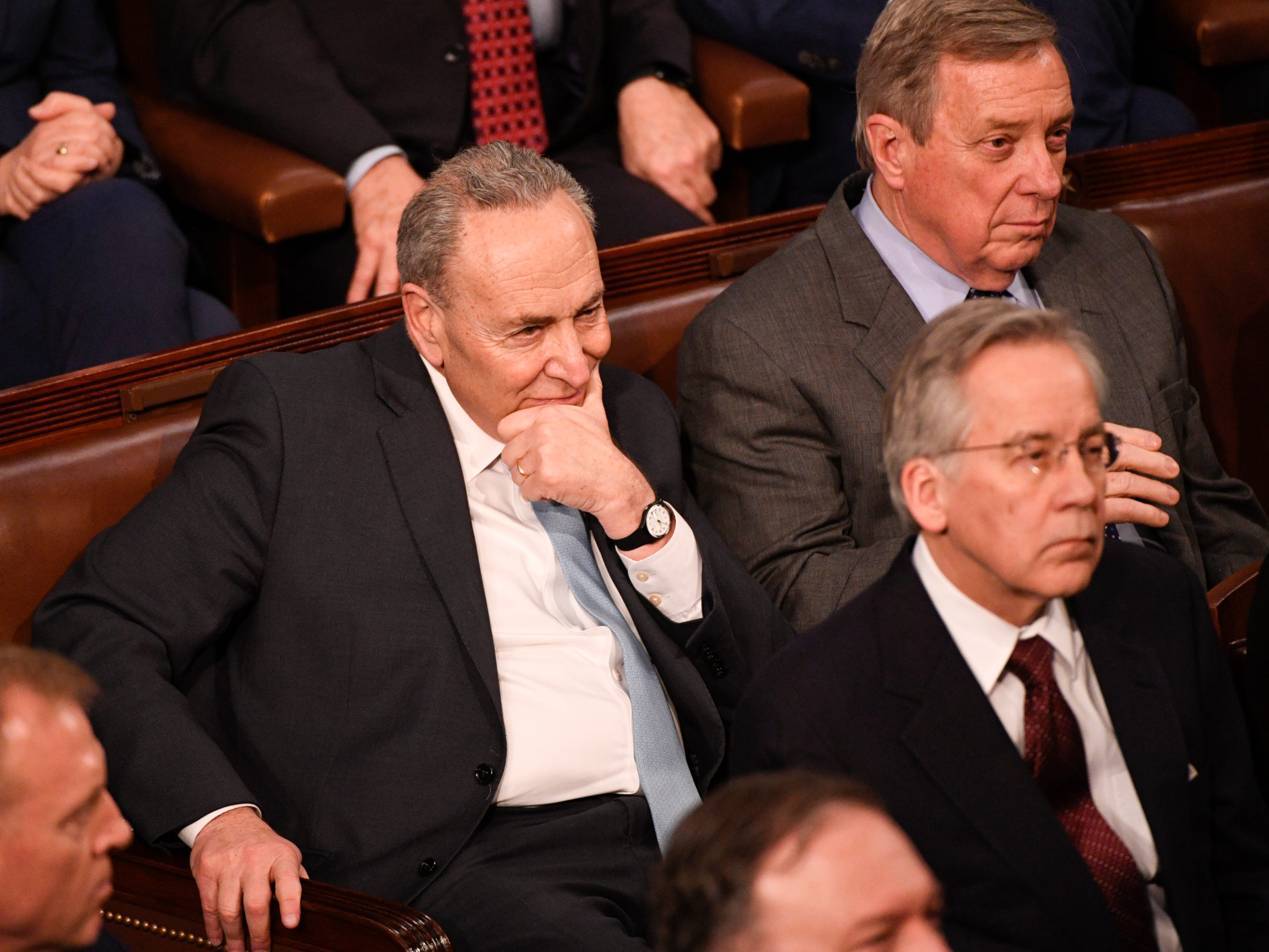 Sen. Chuck Schumer (D-N.Y.) and Sen. Dick Durbin (D-Ill.) listen to President Donald Trump delivers the State of the Union address.