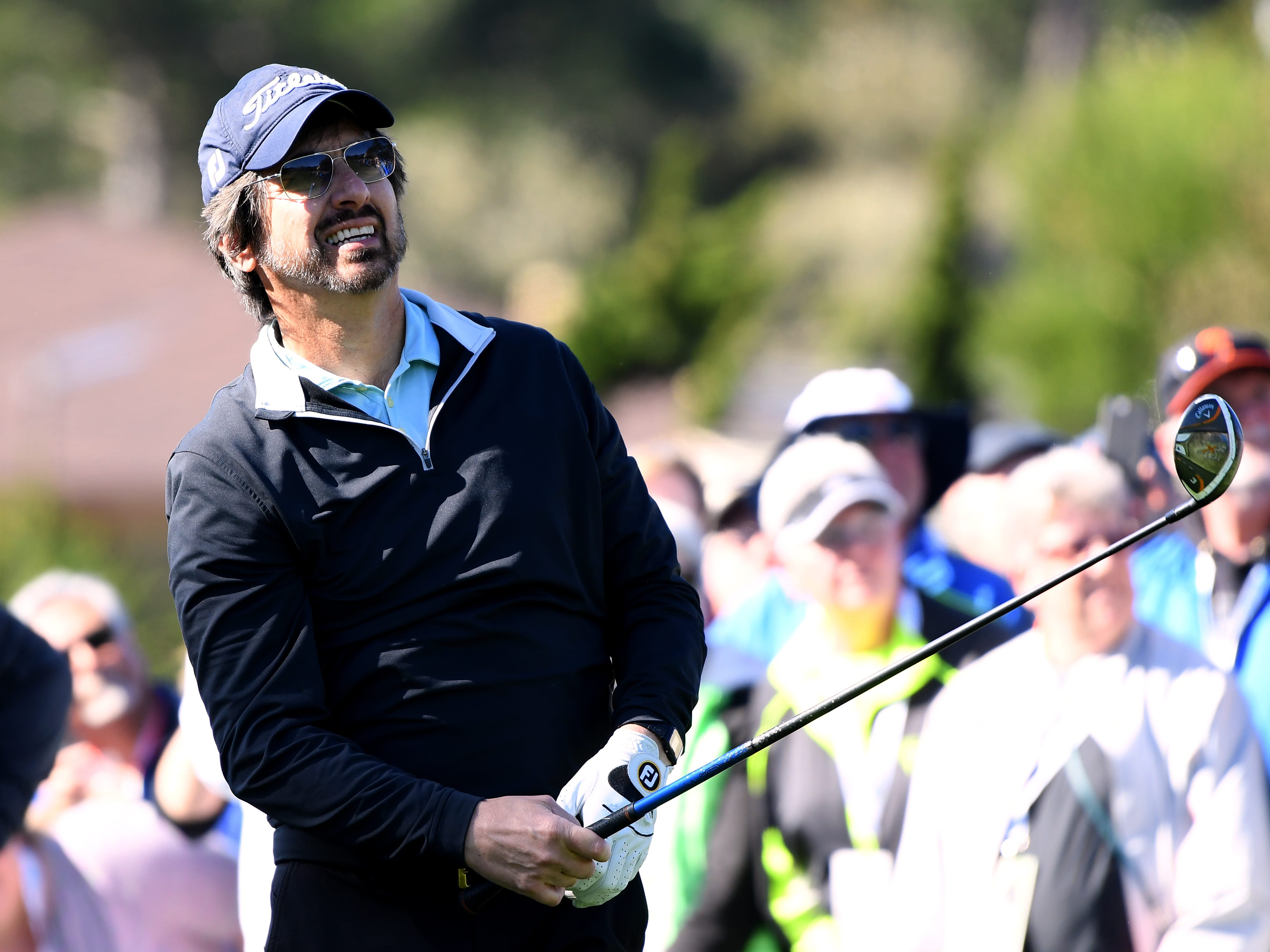 Ray Romano reacts to his shot on the first tee during the 3M Celebrity Challenge at the AT&T Pebble Beach Pro-Am.