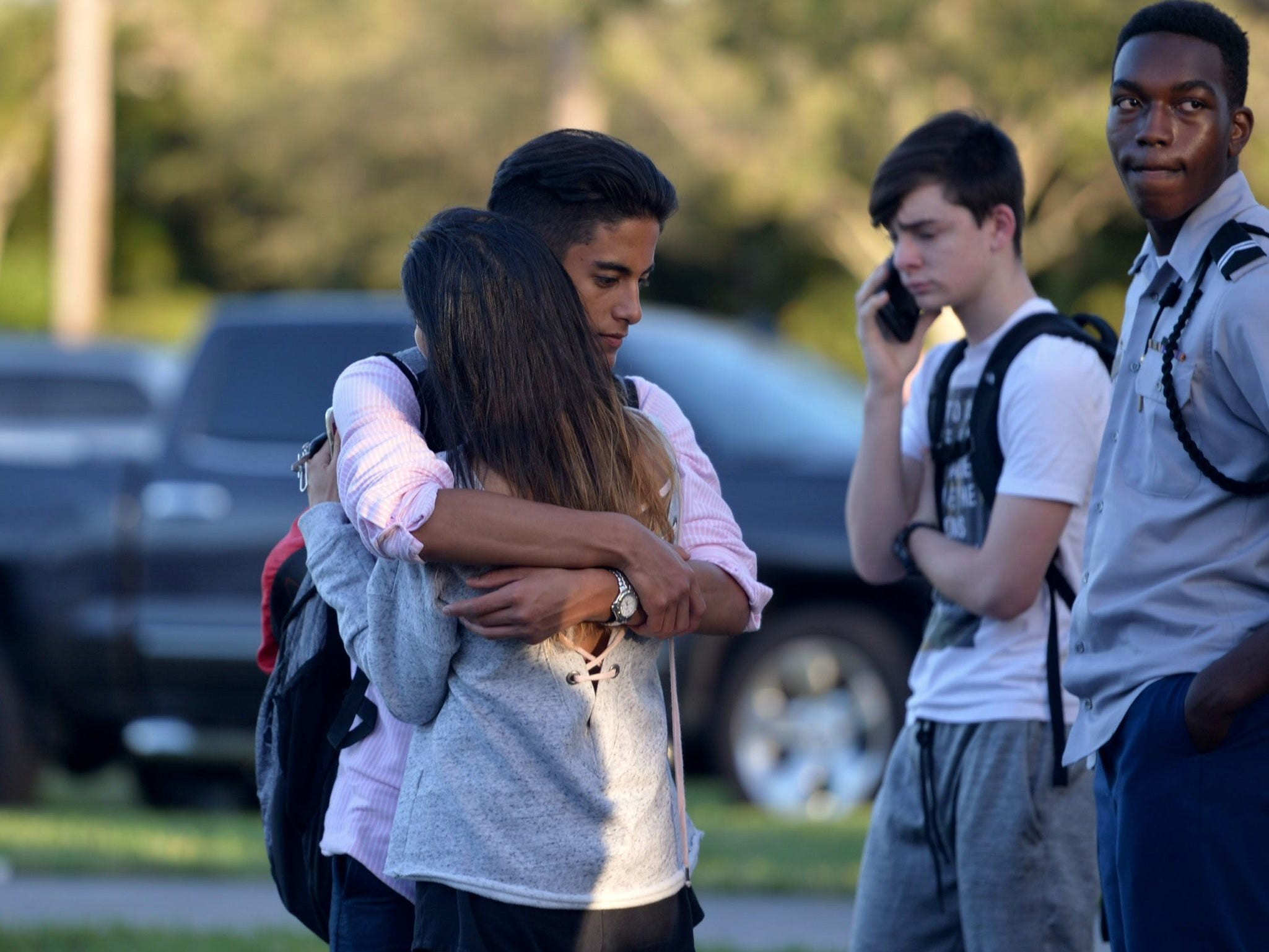 Jorge Zapata, 16, a student at Marjory Stoneman Douglas High School in Parkland, Fla, embraces his mother, Lavinia Zapata, both of Parkland, after a mass shooting on Feb. 14, 2018.