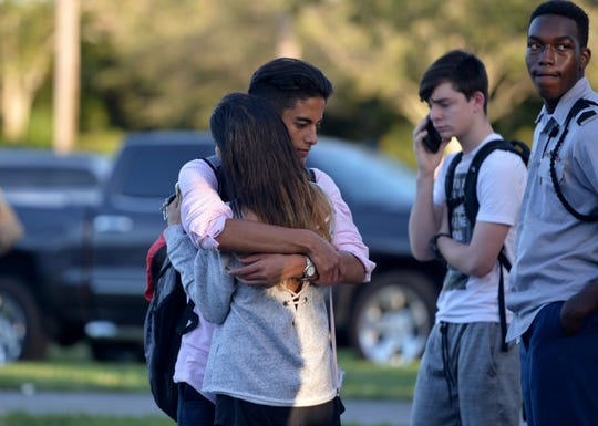 Jorge Zapata, 16, a student at Marjory Stoneman Douglas High School in Parkland, Fla., embraces his mother, Lavinia Zapata, after a mass shooting on Feb. 14, 2018.