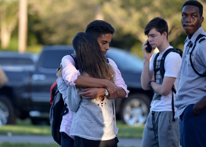 Jorge Zapata, 16, a student at Marjory Stoneman Douglas High School in Parkland, Fla, embraces his mother, Lavinia Zapata, after a mass shooting on Feb. 14, 2018.
