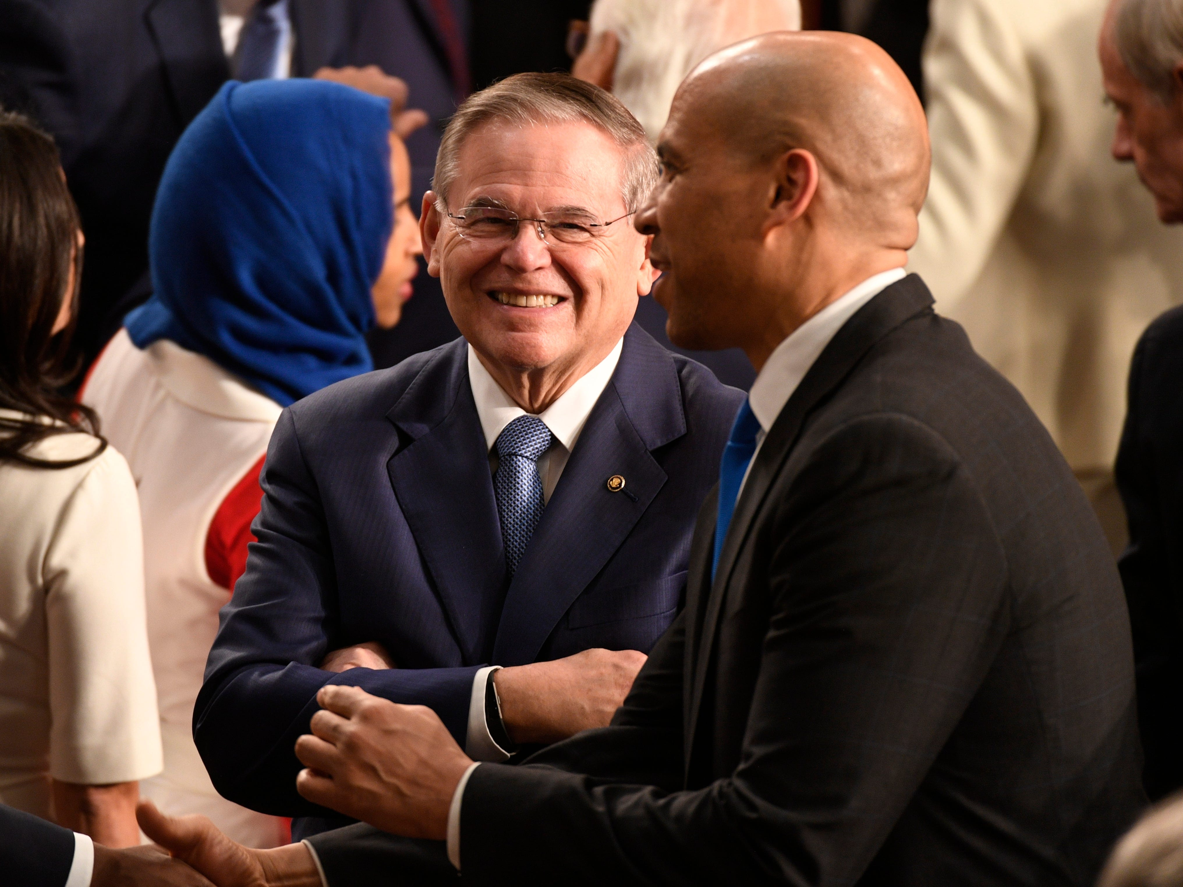 Sen. Bob Menendez (D-N.J.) and Sen. Cory Booker (D-N.J.) talk before President Donald Trump delivers the State of the Union address.