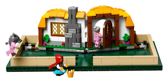 Fans came up with the idea of a little red riding hood cottage, and Talbott simply redesigned it a bit to fit more of a LEGO style.