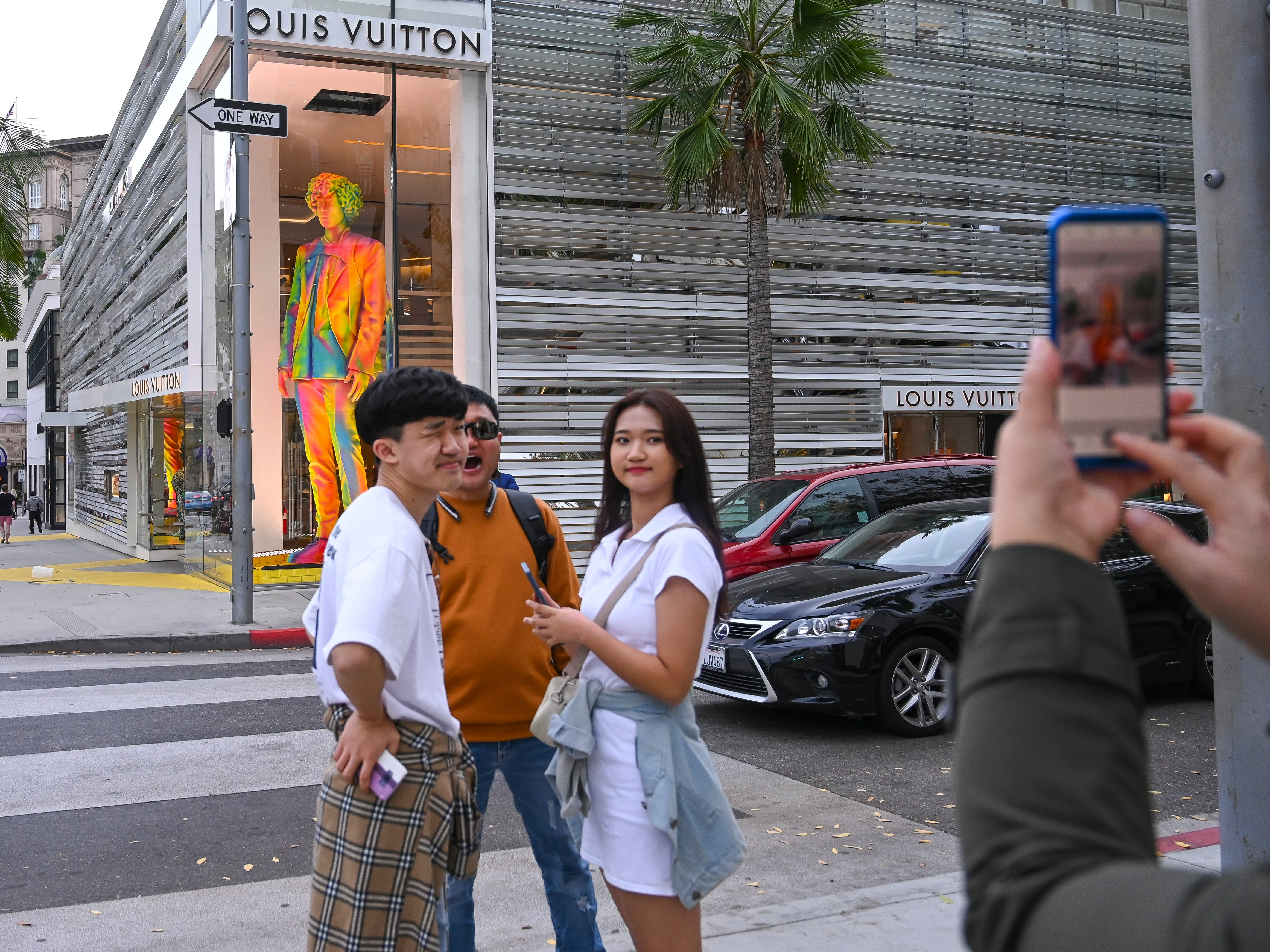 Tourist have a snapshot taken in from of the Louis Vuitton store on Rodeo Drive, Jan. 29, 2019.