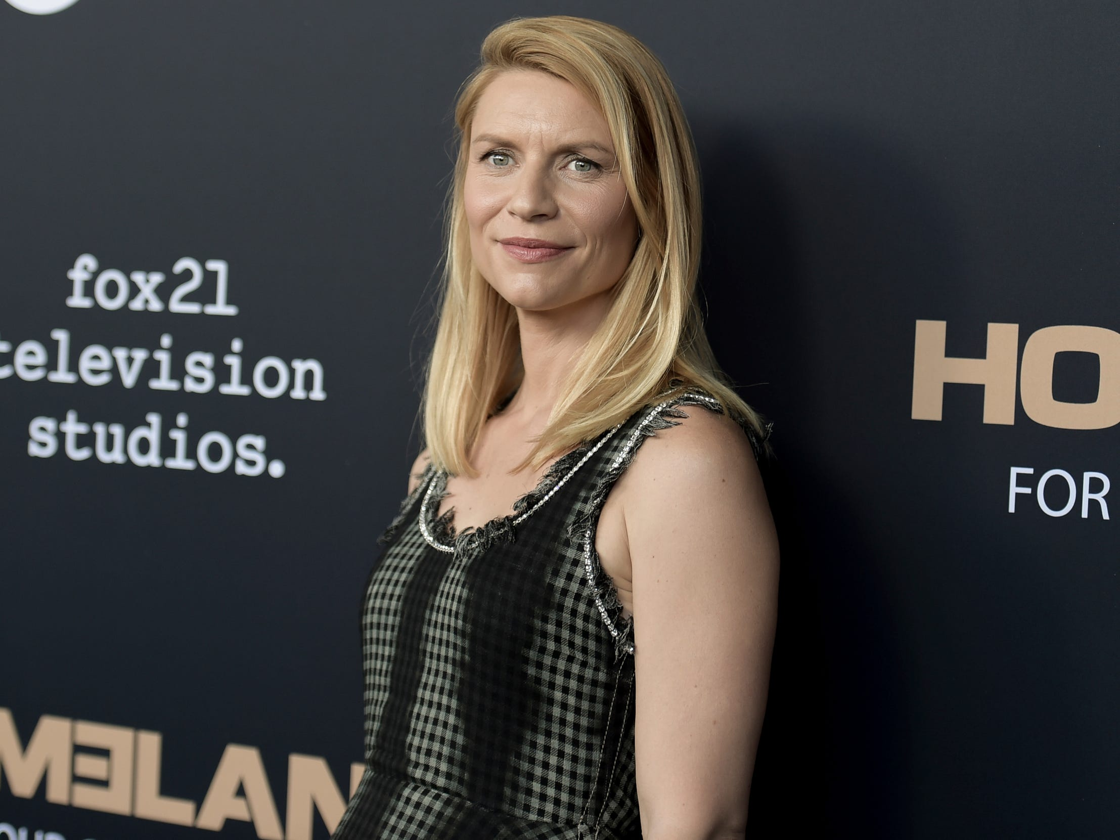 "FILE - In this June 5, 2018, file photo, Claire Danes attends the ""Homeland"" FYC Event at the Writers Guild Theater in Beverly Hills, Calif. ""Homeland"" fans will have to wait longer than expected for the start of the last season. Showtime said that the drama's planned return in June has been pushed back to fall. The complexity of production is the reason for the season-eight delay, Showtime entertainment president Gary Levine said Wednesday, Jan. 30, 2019. (Photo by Richard Shotwell/Invision/AP, File) ORG XMIT: NYHK402"