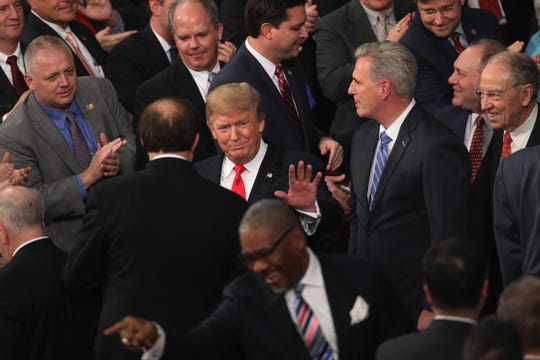 President Donald Trump greets lawmakers after the State of the Union address, Washington, D.C., Feb. 5, 2019.