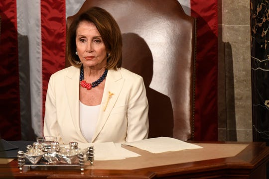 Speaker of the House Nancy Pelosi, D-Calif., listens as President Donald Trump delivers the State of the Union address.