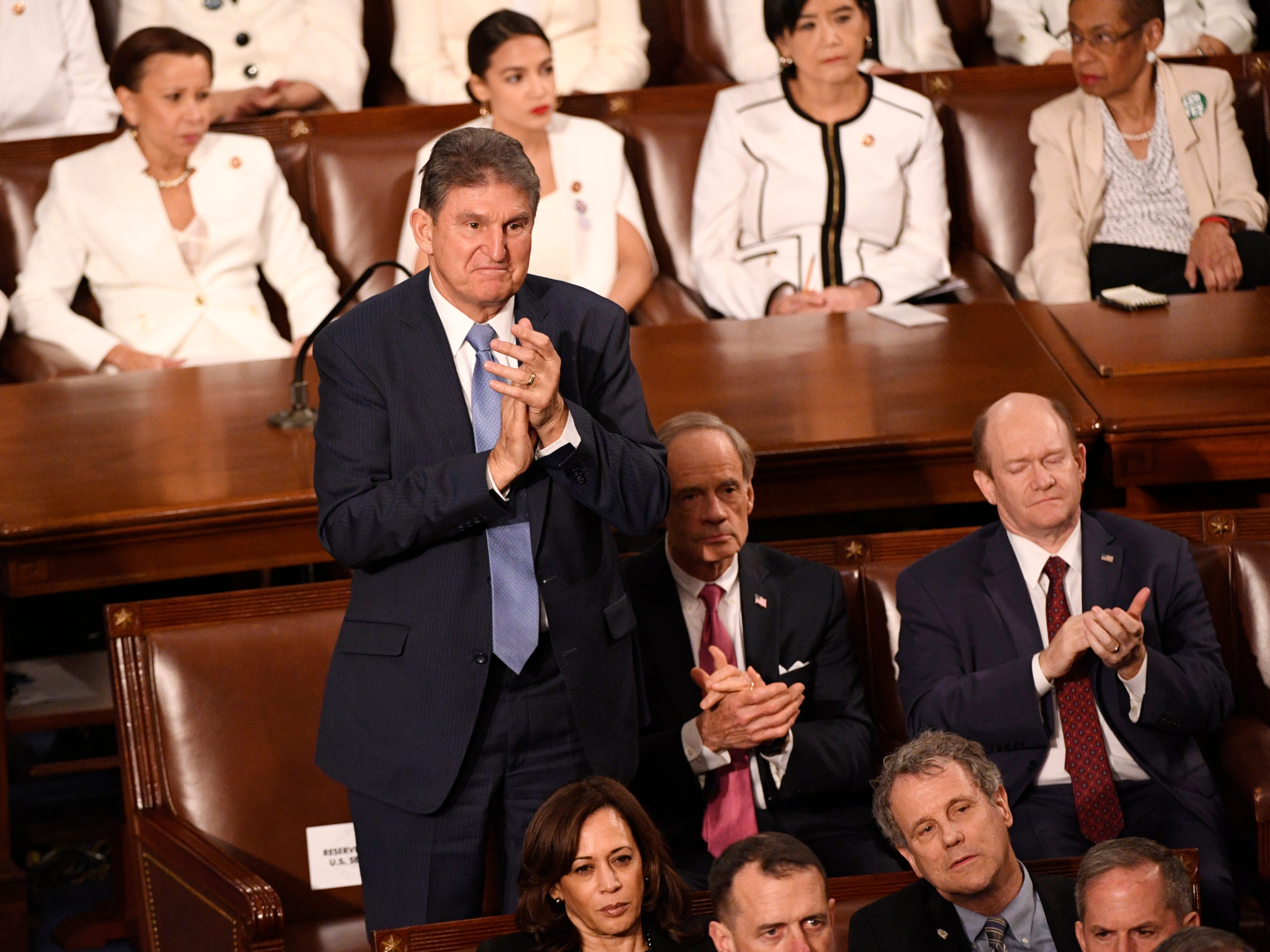 Sen. Joe Manchin (D-W.V.) applauds as President Donald Trump delivers the State of the Union address.