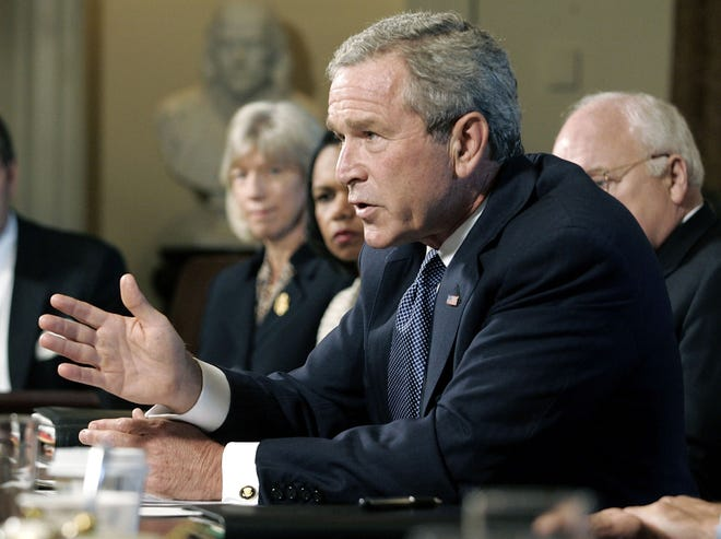 President George W. Bush speaks at a cabinet meeting at the White House in the aftermath of Hurricane Katrina on September 6, 2005.