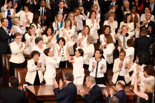 Congresswomen are recognized by President Donald Trump as he delivers the State of the Union address Feb. 5, 2019. The white color choice they wear is meant to honor the women's suffrage movement that led to the ratification of the 19th Amendment in 1920.