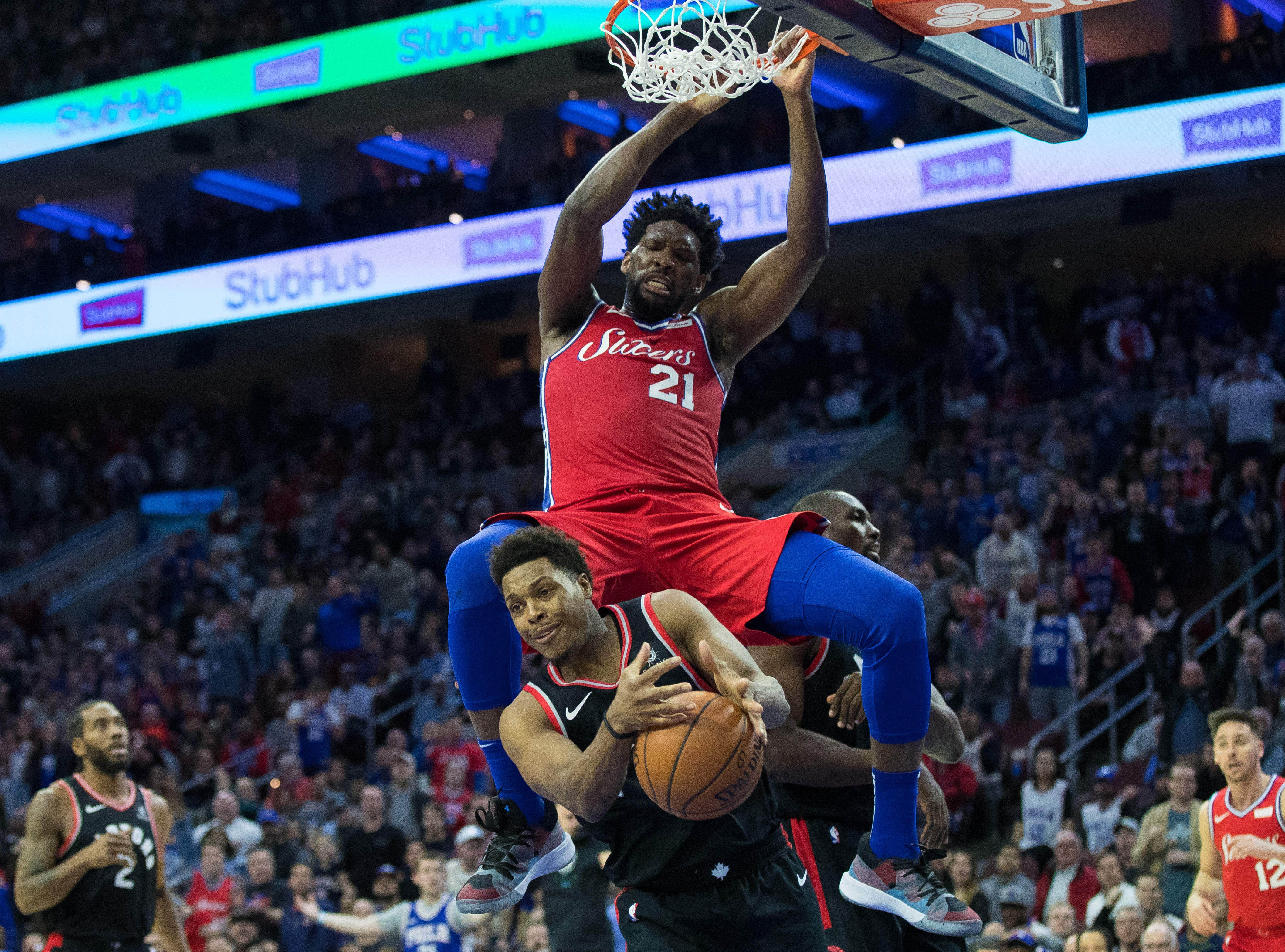 Feb. 5: Philadelphia 76ers center Joel Embiid (21) dunks over Toronto Raptors guard Kyle Lowry (7) during the fourth quarter at Wells Fargo Center.
