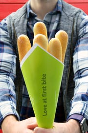 """Buy Olive Garden bread sticks to go and create a """"Breadstick Bouquet."""""""